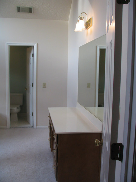 A before picture of our dressing table on the right and door into the shower and toilet room.