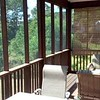 Screened in back deck leading to the backyard
