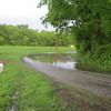 Water over the road in the curve next to our driveway