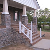 Columns are installed on the front porch; still need to be painted.  Hand railing on steps is going up.