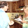 Old kitchen - Skip and Kristanne meal-planning for the troops on Nancy's 60th Birthday Bash.