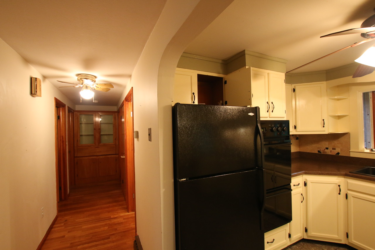 View of kitchen and hallway. Before.