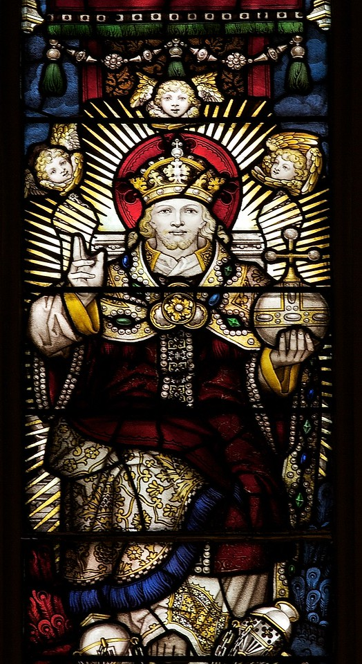 "The Church of the Incarnation Great West Window by C.E. Kempe  The great west window above the main entrance to the nave depicts the Adoration of the Lord as the Risen and Enthroned Christ in Heaven with a gathering of saints and angels. This window echoes the style of fifteenth-century English glass painters and was made by C.E. Kemp of England. Kemp also made the windows in the Chapel of the Nativity. <br><br> C.E. Kemp (1837-1907) came from a well-off family; his uncle was a successful property developer and politician in nearby Brighton, and his grandfather was Lord Mayor of London, according to   <a href=""http://www.britainexpress.com/History/bio/Kempe.htm"">British Express. </a> <br><br> He considered the priesthood, but his severe stammer which was an impediment to preaching. Instead Kempe decided that ""if I was not permitted to minister in the Sanctuary I would use my talents to adorn it"", and subsequently went to study architecture with the firm of a leading ecclesiastical architect George Frederick Bodley, where he learned the aesthetic principles of medieval church art particularly stain glass, according to  <a href=""http://en.wikipedia.org/wiki/Charles_Eamer_Kempe"">Wikipedia.</a> From Britain Express: ""Kempe travelled around Britain and overseas, sketching medieval window designs. Kempe assisted Bodley on two major church projects in the 1860s; All Saints, Cambridge, and St John's, Liverpool. In 1866 the important stained glass makers Clayton and Bell asked Kempe to design a memorial window for Bishop Hooper in Gloucester Cathedral.  <br><br> In 1866 he started his own business in London. Kempe Studios began by supplying vestments, stained glass, and church furnishings. The studio was a success, and enjoyed continual growth throughout the late Victorian period. You could say that he was fortunate, for Kempe Studios began in a period when church architecture and rebuilding was in vogue; the spiritual Renaissance of the Victorian period led to many medieval churches being rebuilt. So suppliers of materials and architectural knowledge were in great demand, and Kempe's work, particularly with stained glass, found a ready market of buyers. <br><br> Kempe decided early on that he needed to use a trademark, and he chose a wheatsheaf, which appears in the Kempe family coat of arms. Finding the wheatsheaf in a set of Kempe windows is a strangely enjoyable pastime for people who enjoy exploring Victorian churches! Kempe was especially active in his native Sussex, where fully 116 churches boast examples of his work. He did not just deal in stained glass, though it is for glass that Kempe is best known. Some of his most important work was with wall painting, such as that at Staplefield, outside Horsham, West Sussex. Aside from the wheatsheaf trademark, one of the characteristic features of a Kempe design is a strong predominence of yellow. <br><br> Kempe's designs - particularly those in stained glass - helped define the style of an age, closely associated with the artwork of the Pre-Raphaelites. When you see a Victorian stained glass window, with its clear, clean colours and romanticised figures, you may not be seeing a Kempe design, but you are almost certainly seeing a design influenced by Kempe. <br><br> Kempe died in 1907, and his company was taken over by WE Tower. But Tower did not enjoy the same success as Kempe, and the company folded in 1934. <br><br> Kempe never married; he was a shy man by nature, though he enjoyed entertaining guests at the house he purchased at Lindfield, West Sussex. He is buried in the churchyard at Ovingdean, the place of his birth."" <br><br> Kempe studios produced over 4,000 stained glass windows."
