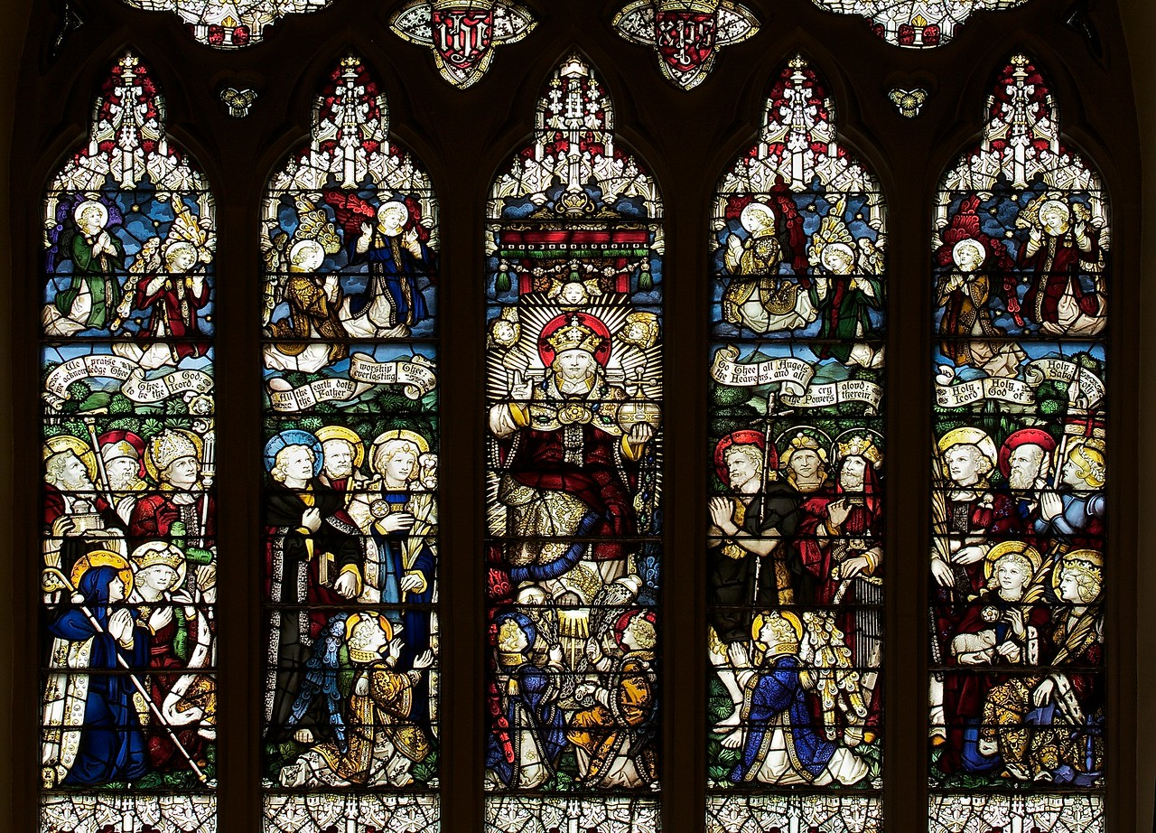"""The Church of the Incarnation Great West Window by C.E. Kempe <br><br> From the  <a href=""""http://www.churchoftheincarnation.org/about-incarnation/landmark-building/the-window-tour/great-west-window-17/"""">Incarnation website:</a> <br><br> """"The great west window above the main entrance to the nave depicts the Adoration of the Lord as the Risen and Enthroned Christ in Heaven with a gathering of saints and angels. Around Christ we see the Virgin Mary, Saint Peter, Saint John, Saint John the baptist, Saint Paul, Isaiah, King David, Saint Jerome, Saint Basil, Saint Columba, Saint Hilda, Saint Helena, Saint Stephen, Saint George, Saint Agnes, and Saint Catherine. In the upper portion, there are angels with scrolls bearing the words of the Te Deum. Below them are angels singing and playing their hymns of praise. This window echoes the style of fifteenth-century English glass painters and was made by C.E. Kemp of England."""" Kemp also made the windows in the Chapel of the Nativity. <br><br> C.E. Kemp (1837-1907) came from a well-off family; his uncle was a successful property developer and politician in nearby Brighton, and his grandfather was Lord Mayor of London, according to   <a href=""""http://www.britainexpress.com/History/bio/Kempe.htm"""">British Express. </a> <br><br> He considered the priesthood, but his severe stammer which was an impediment to preaching. Instead Kempe decided that """"if I was not permitted to minister in the Sanctuary I would use my talents to adorn it"""", and subsequently went to study architecture with the firm of a leading ecclesiastical architect George Frederick Bodley, where he learned the aesthetic principles of medieval church art particularly stain glass, according to  <a href=""""http://en.wikipedia.org/wiki/Charles_Eamer_Kempe"""">Wikipedia.</a> From Britain Express: """"Kempe travelled around Britain and overseas, sketching medieval window designs. Kempe assisted Bodley on two major church projects in the 1860s; All Saints, Cambridge, and St John's, Liverp"""