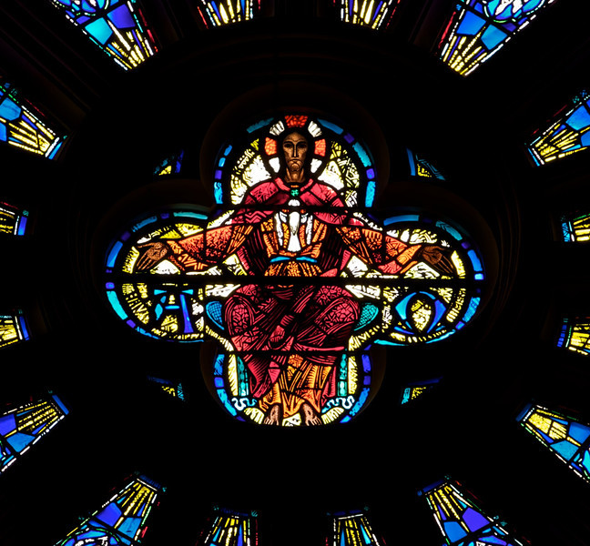 """Saint John the Divine Great Rose Window by Charles Connick (1933)  According to material from the church, Charles Connick designed the Great Rose Window in 1933. """"Christ is surrounded by angels, beatitudes, the four evangelists (Matthew, Mark, Luke, John), the prophets (Isiah, Jeremiah, Daniel and Ezekiel), Divine Love, Seraphim and Divine Wisdom: Cherubim.""""  This is one of the first photos I took with a long telephoto lens, a Canon 70-200 f4 USM. My work up to that point was with much wider angle lenses, 10-22mm or 17-55mm, which provides a nice overall view of a window. However, I wanted a much closer perspective, tight enough to see the artist's detail of the work. Considering the 1.6X crop factor, this was shot at 290mm.  <br><br> Charles Connick (1875–1945) was a prominent artist best known for his work in stained glass in the Gothic Revival style. He was born in Crawford Country, Pennsylvania and developed an interest in drawing at an early age. He left high school when his father became disabled to become an illustrator on the staff of the Pittsburgh Press. At the age of 19, he learned the art of stained glass as an apprentice in the shop of Rudy Brothers in Pittsburgh, where he stayed through 1899. He worked for a number of stained glass companies in Pittsburgh and New York. He went to England and France to study ancient and modern stained glass, including those in the Chartres Cathedral. His first major work was First Baptist Church in Pittsburgh in 1912. Connick settled in Boston opening a stained glass studio in Back Bay in 1913; the Charles J. Connick Associates Studio continued to operate after his death until 1986. He produced many notable windows in such churches as Saint Patrick's Cathedral, Saint John the Divine, the Princeton University Chapel, and Saint Vincent Ferrer. According to Wikipedia, the Charles J. Connick Associates Studio produced some 15,000 windows in more than 5,000 churches and public buildings. <br><br> According to <a href=""""http:/"""