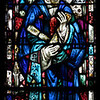"Saint James' Church Stained Glass Window by Charles Connick  Charles Connick designed this window depicting Saint Thomas. <br><br> Connick (1875-1945) produced most of the spectacular stained glass windows in the church. Connick was a prominent artist best known for his work in stained glass in the Gothic Revival style. He was born in Crawford Country, Pennsylvania and developed an interest in drawing at an early age. He left high school when his father became disabled to become an illustrator on the staff of the Pittsburgh Press. At the age of 19, he learned the art of stained glass as an apprentice in the shop of Rudy Brothers in Pittsburgh, where he stayed through 1899. He worked for a number of stained glass companies in Pittsburgh and New York. He went to England and France to study ancient and modern stained glass, including those in the Chartres Cathedral. His first major work was First Baptist Church in Pittsburgh in 1912.  <br><br> Connick settled in Boston opening a stained glass studio in Back Bay in 1913; the Charles J. Connick Associates Studio continued to operate after his death until 1986. He produced many notable windows in such churches as Saint Patrick's Cathedral, Saint John the Divine, the Princeton University Chapel, and Saint Vincent Ferrer. According to Wikipedia, the Charles J. Connick Associates Studio produced some 15,000 windows in more than 5,000 churches and public buildings. <br><br> According to <a href=""http://en.wikipedia.org/wiki/Charles_Connick"">Wikipedia, </a> ""Connick preferred to use clear ""antique"" glass, similar to that of the Middle Ages and praised this type of glass as ""colored radiance, with the lustre, intensity, and baffling vibrant quality of dancing lights."" He employed a technique of ""staggered"" solder-joints in his leading and bars, which English stained-glass historian Peter Cormack says gives the windows their ""syncopated or 'swinging' character."" His style incorporated a strong interest in symbolism as well. Connick expressed the opinion that stained glass's first job was to serve the architectural effect and he believed that his greatest contribution to glasswork was ""rescuing it from the abysmal depth of opalescent picture windows"" of the sort popularized by Louis Comfort Tiffany and John La Farge. Although firmly committed to a regenerated handicraft tradition, Connick welcomed innovation and experimentation in design and technique among his co-workers at his studio."" <br><br> According to the <a href=""http://www.cjconnick.org/"">Charles J. Connick Stained Glass Foundation website</a> ""Using pure, intense color and strong linear design, this guild of artists led the modern revitalization of medieval stained glass craftsmanship in the United States.  Their work reflected a strong interest in symbolism in design and color, and stressed the importance of the relationship between the window's design and its surrounding architecture.  As if with one mind and one pair of hands, the craftsmen in the Connick Studio worked collectively on their windows like the 12th- and 13th- century artisans whose craft inspired them."" <br><br> The Charles J. Connick Stained Glass Foundation was formed after the studio closed in 1986. According to the <a href=""http://www.cjconnick.org/"">foundation website</a> ""The mission of the Charles J. Connick Stained Glass Foundation, Ltd. is to promote the true understanding of the glorious medium of color and light and to preserve and perpetuate the Connick tradition of stained glass."" <br><br> Here is an interesting <a href=""http://video.mit.edu/watch/charles-j-connick-and-mit-10153/"">video from the Massachusetts Institute of Technology</a> on Connick. In December 2008, the foundation donated materials to MIT's Rotch Library of Architecture and Planning to form the Charles J. Connick Stained Glass Foundation Collection."