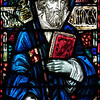 "Saint James' Church Stained Glass Window by Charles Connick  Charles Connick designed this window depicting Saint James the Great, the patron saint of the parish. <br><br> Connick (1875-1945) produced most of the spectacular stained glass windows in the church. Connick was a prominent artist best known for his work in stained glass in the Gothic Revival style. He was born in Crawford Country, Pennsylvania and developed an interest in drawing at an early age. He left high school when his father became disabled to become an illustrator on the staff of the Pittsburgh Press. At the age of 19, he learned the art of stained glass as an apprentice in the shop of Rudy Brothers in Pittsburgh, where he stayed through 1899. He worked for a number of stained glass companies in Pittsburgh and New York. He went to England and France to study ancient and modern stained glass, including those in the Chartres Cathedral. His first major work was First Baptist Church in Pittsburgh in 1912.  <br><br> Connick settled in Boston opening a stained glass studio in Back Bay in 1913; the Charles J. Connick Associates Studio continued to operate after his death until 1986. He produced many notable windows in such churches as Saint Patrick's Cathedral, Saint John the Divine, the Princeton University Chapel, and Saint Vincent Ferrer. According to Wikipedia, the Charles J. Connick Associates Studio produced some 15,000 windows in more than 5,000 churches and public buildings. <br><br> According to <a href=""http://en.wikipedia.org/wiki/Charles_Connick"">Wikipedia, </a> ""Connick preferred to use clear ""antique"" glass, similar to that of the Middle Ages and praised this type of glass as ""colored radiance, with the lustre, intensity, and baffling vibrant quality of dancing lights."" He employed a technique of ""staggered"" solder-joints in his leading and bars, which English stained-glass historian Peter Cormack says gives the windows their ""syncopated or 'swinging' character."" His style incorporated a strong interest in symbolism as well. Connick expressed the opinion that stained glass's first job was to serve the architectural effect and he believed that his greatest contribution to glasswork was ""rescuing it from the abysmal depth of opalescent picture windows"" of the sort popularized by Louis Comfort Tiffany and John La Farge. Although firmly committed to a regenerated handicraft tradition, Connick welcomed innovation and experimentation in design and technique among his co-workers at his studio."" <br><br> According to the <a href=""http://www.cjconnick.org/"">Charles J. Connick Stained Glass Foundation website</a> ""Using pure, intense color and strong linear design, this guild of artists led the modern revitalization of medieval stained glass craftsmanship in the United States.  Their work reflected a strong interest in symbolism in design and color, and stressed the importance of the relationship between the window's design and its surrounding architecture.  As if with one mind and one pair of hands, the craftsmen in the Connick Studio worked collectively on their windows like the 12th- and 13th- century artisans whose craft inspired them."" <br><br> The Charles J. Connick Stained Glass Foundation was formed after the studio closed in 1986. According to the <a href=""http://www.cjconnick.org/"">foundation website</a> ""The mission of the Charles J. Connick Stained Glass Foundation, Ltd. is to promote the true understanding of the glorious medium of color and light and to preserve and perpetuate the Connick tradition of stained glass."" <br><br> Here is an interesting <a href=""http://video.mit.edu/watch/charles-j-connick-and-mit-10153/"">video from the Massachusetts Institute of Technology</a> on Connick. In December 2008, the foundation donated materials to MIT's Rotch Library of Architecture and Planning to form the Charles J. Connick Stained Glass Foundation Collection."