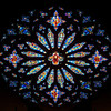 "Saint John the Divine Great Rose Window by Charles Connick (1933)  According to material from the church, Charles Connick designed the Great Rose Window in 1933. ""Christ is surrounded by angels, beatitudes, the four evangelists (Matthew, Mark, Luke, John), the prophets (Isiah, Jeremiah, Daniel and Ezekiel), Divine Love, Seraphim and Divine Wisdom: Cherubim.""  This is one of the first photos I took with a long telephoto lens, a Canon 70-200 f4 USM. My work up to that point was with much wider angle lenses, 10-22mm or 17-55mm, which provides a nice overall view of a window. However, I wanted a much closer perspective, tight enough to see the artist's detail of the work. Considering the 1.6X crop factor, this was shot at 112mm.  <br><br> Charles Connick (1875–1945) was a prominent artist best known for his work in stained glass in the Gothic Revival style. He was born in Crawford Country, Pennsylvania and developed an interest in drawing at an early age. He left high school when his father became disabled to become an illustrator on the staff of the Pittsburgh Press. At the age of 19, he learned the art of stained glass as an apprentice in the shop of Rudy Brothers in Pittsburgh, where he stayed through 1899. He worked for a number of stained glass companies in Pittsburgh and New York. He went to England and France to study ancient and modern stained glass, including those in the Chartres Cathedral. His first major work was First Baptist Church in Pittsburgh in 1912. Connick settled in Boston opening a stained glass studio in Back Bay in 1913; the Charles J. Connick Associates Studio continued to operate after his death until 1986. He produced many notable windows in such churches as Saint Patrick's Cathedral, Saint John the Divine, the Princeton University Chapel, and Saint Vincent Ferrer. According to Wikipedia, the Charles J. Connick Associates Studio produced some 15,000 windows in more than 5,000 churches and public buildings. <br><br> According to <a href=""http://en.wikipedia.org/wiki/Charles_Connick"">Wikipedia, </a> ""Connick preferred to use clear ""antique"" glass, similar to that of the Middle Ages and praised this type of glass as ""colored radiance, with the lustre, intensity, and baffling vibrant quality of dancing lights."" He employed a technique of ""staggered"" solder-joints in his leading and bars, which English stained-glass historian Peter Cormack says gives the windows their ""syncopated or 'swinging' character."" His style incorporated a strong interest in symbolism as well. Connick expressed the opinion that stained glass's first job was to serve the architectural effect and he believed that his greatest contribution to glasswork was ""rescuing it from the abysmal depth of opalescent picture windows"" of the sort popularized by Louis Comfort Tiffany and John La Farge. Although firmly committed to a regenerated handicraft tradition, Connick welcomed innovation and experimentation in design and technique among his co-workers at his studio."" <br><br> According to the <a href=""http://www.cjconnick.org/"">Charles J. Connick Stained Glass Foundation website</a> ""Using pure, intense color and strong linear design, this guild of artists led the modern revitalization of medieval stained glass craftsmanship in the United States.  Their work reflected a strong interest in symbolism in design and color, and stressed the importance of the relationship between the window's design and its surrounding architecture.  As if with one mind and one pair of hands, the craftsmen in the Connick Studio worked collectively on their windows like the 12th- and 13th- century artisans whose craft inspired them."" <br><br> The Charles J. Connick Stained Glass Foundation was formed after the studio closed in 1986. According to the <a href=""http://www.cjconnick.org/"">foundation website</a> ""The mission of the Charles J. Connick Stained Glass Foundation, Ltd. is to promote the true understanding of the glorious medium of color and light and to preserve and perpetuate the Connick tradition of stained glass."" <br><br> Here is an interesting <a href=""http://video.mit.edu/watch/charles-j-connick-and-mit-10153/"">video from the Massachusetts Institute of Technology</a> on Connick. In December 2008, the foundation donated materials to the MIT's Rotch Library of Architecture and Planning to form the Charles J. Connick Stained Glass Foundation Collection."