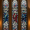 "Saint James' Church Stained Glass Window of Thomas, Matthew, and James the Less by Charles Connick <br><br> Connick (1875-1945) produced most of the spectacular stained glass windows in the church. Connick was a prominent artist best known for his work in stained glass in the Gothic Revival style. He was born in Crawford Country, Pennsylvania and developed an interest in drawing at an early age. He left high school when his father became disabled to become an illustrator on the staff of the Pittsburgh Press. At the age of 19, he learned the art of stained glass as an apprentice in the shop of Rudy Brothers in Pittsburgh, where he stayed through 1899. He worked for a number of stained glass companies in Pittsburgh and New York. He went to England and France to study ancient and modern stained glass, including those in the Chartres Cathedral. His first major work was First Baptist Church in Pittsburgh in 1912.  <br><br> Connick settled in Boston opening a stained glass studio in Back Bay in 1913; the Charles J. Connick Associates Studio continued to operate after his death until 1986. He produced many notable windows in such churches as Saint Patrick's Cathedral, Saint John the Divine, the Princeton University Chapel, and Saint Vincent Ferrer. According to Wikipedia, the Charles J. Connick Associates Studio produced some 15,000 windows in more than 5,000 churches and public buildings. <br><br> According to <a href=""http://en.wikipedia.org/wiki/Charles_Connick"">Wikipedia, </a> ""Connick preferred to use clear ""antique"" glass, similar to that of the Middle Ages and praised this type of glass as ""colored radiance, with the lustre, intensity, and baffling vibrant quality of dancing lights."" He employed a technique of ""staggered"" solder-joints in his leading and bars, which English stained-glass historian Peter Cormack says gives the windows their ""syncopated or 'swinging' character."" His style incorporated a strong interest in symbolism as well. Connick expressed the opinion that stained glass's first job was to serve the architectural effect and he believed that his greatest contribution to glasswork was ""rescuing it from the abysmal depth of opalescent picture windows"" of the sort popularized by Louis Comfort Tiffany and John La Farge. Although firmly committed to a regenerated handicraft tradition, Connick welcomed innovation and experimentation in design and technique among his co-workers at his studio."" <br><br> According to the <a href=""http://www.cjconnick.org/"">Charles J. Connick Stained Glass Foundation website</a> ""Using pure, intense color and strong linear design, this guild of artists led the modern revitalization of medieval stained glass craftsmanship in the United States.  Their work reflected a strong interest in symbolism in design and color, and stressed the importance of the relationship between the window's design and its surrounding architecture.  As if with one mind and one pair of hands, the craftsmen in the Connick Studio worked collectively on their windows like the 12th- and 13th- century artisans whose craft inspired them."" <br><br> The Charles J. Connick Stained Glass Foundation was formed after the studio closed in 1986. According to the <a href=""http://www.cjconnick.org/"">foundation website</a> ""The mission of the Charles J. Connick Stained Glass Foundation, Ltd. is to promote the true understanding of the glorious medium of color and light and to preserve and perpetuate the Connick tradition of stained glass."" <br><br> Here is an interesting <a href=""http://video.mit.edu/watch/charles-j-connick-and-mit-10153/"">video from the Massachusetts Institute of Technology</a> on Connick. In December 2008, the foundation donated materials to MIT's Rotch Library of Architecture and Planning to form the Charles J. Connick Stained Glass Foundation Collection."