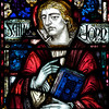 "Saint James' Church Stained Glass Window by Charles Connick  Charles Connick designed this window depicting Saint John. <br><br> Connick (1875-1945) produced most of the spectacular stained glass windows in the church. Connick was a prominent artist best known for his work in stained glass in the Gothic Revival style. He was born in Crawford Country, Pennsylvania and developed an interest in drawing at an early age. He left high school when his father became disabled to become an illustrator on the staff of the Pittsburgh Press. At the age of 19, he learned the art of stained glass as an apprentice in the shop of Rudy Brothers in Pittsburgh, where he stayed through 1899. He worked for a number of stained glass companies in Pittsburgh and New York. He went to England and France to study ancient and modern stained glass, including those in the Chartres Cathedral. His first major work was First Baptist Church in Pittsburgh in 1912.  <br><br> Connick settled in Boston opening a stained glass studio in Back Bay in 1913; the Charles J. Connick Associates Studio continued to operate after his death until 1986. He produced many notable windows in such churches as Saint Patrick's Cathedral, Saint John the Divine, the Princeton University Chapel, and Saint Vincent Ferrer. According to Wikipedia, the Charles J. Connick Associates Studio produced some 15,000 windows in more than 5,000 churches and public buildings. <br><br> According to <a href=""http://en.wikipedia.org/wiki/Charles_Connick"">Wikipedia, </a> ""Connick preferred to use clear ""antique"" glass, similar to that of the Middle Ages and praised this type of glass as ""colored radiance, with the lustre, intensity, and baffling vibrant quality of dancing lights."" He employed a technique of ""staggered"" solder-joints in his leading and bars, which English stained-glass historian Peter Cormack says gives the windows their ""syncopated or 'swinging' character."" His style incorporated a strong interest in symbolism as well. Connick expressed the opinion that stained glass's first job was to serve the architectural effect and he believed that his greatest contribution to glasswork was ""rescuing it from the abysmal depth of opalescent picture windows"" of the sort popularized by Louis Comfort Tiffany and John La Farge. Although firmly committed to a regenerated handicraft tradition, Connick welcomed innovation and experimentation in design and technique among his co-workers at his studio."" <br><br> According to the <a href=""http://www.cjconnick.org/"">Charles J. Connick Stained Glass Foundation website</a> ""Using pure, intense color and strong linear design, this guild of artists led the modern revitalization of medieval stained glass craftsmanship in the United States.  Their work reflected a strong interest in symbolism in design and color, and stressed the importance of the relationship between the window's design and its surrounding architecture.  As if with one mind and one pair of hands, the craftsmen in the Connick Studio worked collectively on their windows like the 12th- and 13th- century artisans whose craft inspired them."" <br><br> The Charles J. Connick Stained Glass Foundation was formed after the studio closed in 1986. According to the <a href=""http://www.cjconnick.org/"">foundation website</a> ""The mission of the Charles J. Connick Stained Glass Foundation, Ltd. is to promote the true understanding of the glorious medium of color and light and to preserve and perpetuate the Connick tradition of stained glass."" <br><br> Here is an interesting <a href=""http://video.mit.edu/watch/charles-j-connick-and-mit-10153/"">video from the Massachusetts Institute of Technology</a> on Connick. In December 2008, the foundation donated materials to MIT's Rotch Library of Architecture and Planning to form the Charles J. Connick Stained Glass Foundation Collection."