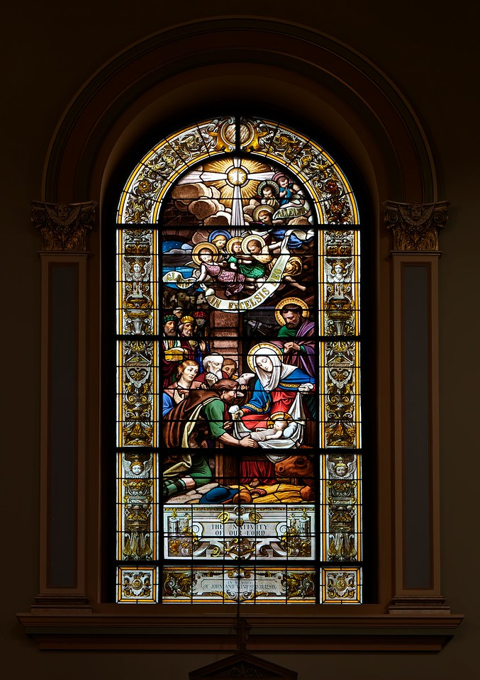 "Saint Jean Baptiste Catholic Church Stained Glass Windows <br><br> From the<a href=""http://stjeanbaptisteny.org/History/Architectural-Tour""> Saint Jean Baptiste website,</a> number 4: <br><br> ""Saint Jean Baptiste features several sets of stained glass windows.  The most important and visually dominant are the windows of the nave (including the apsidal chapels) and clerestory (second level).  These beautiful windows were designed and crafted by the Chartres, France, atelier of Charles Lorin between 1914 and 1919.  Due to the danger of shipping during World War I, they were kept in France and, therefore, not installed until 1920.  Along with the Lorin windows in Saint Patrick's Cathedral, these are the only examples in New York of the superb craftsmanship of this workshop.  <br><br> Like most of the church's decorative elements, the windows reflect the Eucharistic focus of Saint Jean Baptiste and the Congregation of the Blessed Sacrament.  The nave windows depict events in the life of Christ (mostly on the north wall) and subsequent Eucharistic events or doctrines in the life of the Catholic Church (south wall).  The clerestory windows depict Old Testament scenes that are pre-figurations of the events in the lower windows, once again with an emphasis on those that pre-figure the Eucharist.  The forms and compositions of the designs may be traced to the great tradition of French classicizing history painting, from Poussin in the seventeenth century to nineteenth-century masters such as Ingres and his followers."" <br><br> From the website of <a href=""http://sjearchives.org/history-of-the-stained-glass-windows.php"">Saint John the Evangelist Catholic Church in Green Bay, Wisconsin:</a> <br><br> ""The ""Lorin de Chartres"" Studio or Atelier Lorin was founded by Nicolas Lorin (1815 – 1882), a master of painted and stained French art glass, in 1863.  His wife, Madame Veuve Lorin and his son Charles Lorin (1874 – 1940) took over the studio upon Nicolas' death. The Lorin Studio restored medieval glass and created many stained glass windows around the world including windows in St. Patrick's Cathedral in New York, the Cathedral Notre Dame de Chartres in France, the Miracle of St. Nicolas in the Monaco Cathedral, and the Eglise Saint Jean Baptiste in New York. Today the Lorin Company is the oldest stained glass workshop in Chartres.  Chartres is noted for its stained glass designs and is the home of Centre International du Vitrail Museum dedicated to stained glass technology. <br><br> Jacques-Louis David and Jean-August Ingres, two important French neo-classical painters who weren't known for their religious works, influenced Nicolas and Charles Lorin but the inspiration might have come from their style. Charles Alexandre Crauk, a painter of religious and historical paintings and head of the Lorin drawing studio, was also influenced by the neoclassical style. The neoclassical artists were known for an artistic style that emphasized symmetry, austerity, clean lines, a revival of the classical themes of history and mythology, attention to detail, bold figures in sharp vibrant colors, and a quest for beauty.  The neoclassical paintings had clear, bold outlines against pastel or darker back grounds, enhancing the important figures or groups within the scene. The effects of light were not a mere accident, in most cases, light signaled vitality, darkness represented death."""