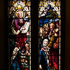"The Church of the Incarnation, Moses and the Law by Heaton, Butler, and Bayne <br><br> This is an Old Testament window, the lower portion  shows Moses giving the Law. <br><br> Clement Heaton originally founded his stained glass firm in 1852, joined by James Butler in 1855. Between 1859-61 they worked alongside Clayton and Bell and were joined by Robert Turnill Bayne, who became their sole designer and a full partner in the firm from 1862. His windows show strong design and color, and are often recognizable by the inclusion of at least one figure with Bayne's features and long beard to <a href=""http://en.wikipedia.org/wiki/Heaton,_Butler_and_Bayne"">Wikipedia.</a>. They established their studio in Covent Garden, London, and went on to become one of the leading firms of Gothic Revival stained glass manufacturers, whose work was commissioned by the principal Victorian architects. A change in direction came with their production of windows to the designs of Henry Holiday in 1868, which show a more classical influence at work. During a long career, the firm produced stained glass for numerous churches throughout the U.K. and the U.S. <br><br> During the Medieval period, from the Norman Conquest of England in 1066 until the 1530s, much stained glass was produced and installed in churches, monasteries and cathedrals. Two historic events had brought an end to this and the destruction of most of the glass-the Dissolution of the Monasteries under Henry VIII and the Puritan era under Oliver Cromwell in the 17th century. <br><br> The early 19th century was marked by a renewal of the Christian faith, a growth of Roman Catholicism, a planting of new churches, particularly in centers of industrial growth and the restoration of many ancient churches and cathedrals. In the 1850s a number of young designers worked in conjunction with the leading Gothic Revival architects in the provision of stained glass for new churches and for the restoration of old; the work of John Richard Clayton, Alfred Bell, Clement Heaton, James Butler, Robert Bayne, can be found in Incarnation."