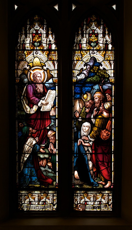 """The Church of the Incarnation, Moses and the Law by Heaton, Butler, and Bayne <br><br> This is an Old Testament window, the lower portion  shows Moses giving the Law. <br><br> Clement Heaton originally founded his stained glass firm in 1852, joined by James Butler in 1855. Between 1859-61 they worked alongside Clayton and Bell and were joined by Robert Turnill Bayne, who became their sole designer and a full partner in the firm from 1862. His windows show strong design and color, and are often recognizable by the inclusion of at least one figure with Bayne's features and long beard to <a href=""""http://en.wikipedia.org/wiki/Heaton,_Butler_and_Bayne"""">Wikipedia.</a>. They established their studio in Covent Garden, London, and went on to become one of the leading firms of Gothic Revival stained glass manufacturers, whose work was commissioned by the principal Victorian architects. A change in direction came with their production of windows to the designs of Henry Holiday in 1868, which show a more classical influence at work. During a long career, the firm produced stained glass for numerous churches throughout the U.K. and the U.S. <br><br> During the Medieval period, from the Norman Conquest of England in 1066 until the 1530s, much stained glass was produced and installed in churches, monasteries and cathedrals. Two historic events had brought an end to this and the destruction of most of the glass-the Dissolution of the Monasteries under Henry VIII and the Puritan era under Oliver Cromwell in the 17th century. <br><br> The early 19th century was marked by a renewal of the Christian faith, a growth of Roman Catholicism, a planting of new churches, particularly in centers of industrial growth and the restoration of many ancient churches and cathedrals. In the 1850s a number of young designers worked in conjunction with the leading Gothic Revival architects in the provision of stained glass for new churches and for the restoration of old; the work of John Richard Clayton"""