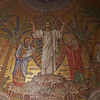 "Saint Bartholomew's Church, ""Transfiguration of Christ"" Mosaic in the Apse above the Altar by Hildreth Meière <br><br> Hildreth Meière (1892-1961) was one of the most influential and creative decorative artists of the 20th century  and ranks with a small number of women artists whose achievements gained the recognition of the art world in the first half of the century according to the <a href=""http://www.hildrethmeiere.com""> International Hildreth Meiere Association website.</a>  She was born in New York  City. After studying in Florence and exposed to the Renaissance masters, she said ""After that I could not be satisfied with anything less than a big wall to paint on. I just had to be a mural painter,"" according to <a href=""http://en.wikipedia.org/wiki/Hildreth_Meiere""> Wikipedia.</a>  She continued her studies at the Art Students League of New York, the School of the Art Institute of Chicago, New York School of Applied Design for Women. She served as a draftsman in the U.S. Navy during World War I after training as a mapmaker. ""Her military service proved to be a valuable addition to her training for her career as a mural painter and designer,"" according to the Meière website.  <br><br> After the war, she was introduced to Bertram Goodhue, one of America's leading architects. Goodhue gave her the opportunity to paint the high altar for one of his church projects, Saint Mark's Episcopal Church in Mt. Kisco, New York. Afterward, she did most of the mural work for Goodhue's firm. <br><br> She next worked with Goodhue on the National Academy of Sciences building in Washington, D.C. He chose her to do the decorative mosaic work for the dome and arches in the Great Hall.  <br><br> Goodhue was selected the architect for the Nebraska state Capital in Lincoln. He gave her a great opportunity as the principal designer of the decorative art for the interior of the building to interpret the history and symbolism of the state of Nebraska. She received eight commissions over the next eight years to design the dome, ceilings, floors, and various spaces in the building.  <br><br> Meière received a Gold Medal from the Architectural League of New York in 1928 for her work on the Nebraska State Capital. This project was at the beginning of her career and established her as a leading designer of mural and mosaic work and interiors, according to the Meière website. <br><br> In 1928.1929, she had commissions to design interior mosaics for Temple Emanu-El and Saint Bartholomew's in New York City. For Saint Bartholomew's, she used glass mosaic for the ""Tranfiguration of Christ"" in the apse above the Altar.  <br><br> Meière served on the Citizen's Committee for the Army and Navy, providing altarpieces for military chaplains used on base camps, battleships, and hospitals worldwide.  <br><br> She served as President of the National Society of Mural Painters and the Liturgical arts Society, First Vice President of the Architectural League of New York (one of the first women members, she received its Gold Medal in Mural Painting in 1928), director of the Municipal Arts Society, and Associate of the National Academy of Design, and was appointed the first woman on the New York City Art Commission.  <br><br> Some of her most notable work includes: <br><br> Mosaics for the Great Hall of the National Academy of Sciences, Washington, D.C.; Evolution-themed floor and ceiling art in Nebraska's State Capital, Lincoln, Nebraska; Saint Bartholomew's glass mosaic for the ""Transfiguration of Christ"" in the apse above the altar, New York City; 75-foot mosaic arch over the sanctuary, and mosaics surrounding the Torah-shaped bronze arc, Temple Emanu-El, New York City; Radio Center Music Hall building façade: three metal rondels called Song, Drama, and Dance; Washington National Cathedral, ""The Resurrected Christ"". <br><br> From the Meière website: <br><br> ""Hildreth Meière as an artist was a significant figure in several important areas of American visual culture.  First, she was most famous as an Art Deco muralist and decorator whose work stands among the most distinguished of her era.  Second, she is an important figure in the history of American Liturgical Art, and one of its most ecumenical practitioners.  Third, she is one of the preeminent mosaicists in the history of American art.  Finally, she is a woman artist who was able to gain the respect of the greatest muralists and architects of her day.  In 1956 she was the first woman honored with The Fine Arts Medal of the American Institute of Architects:  <br><br> A Master of Murals: the world of art might write your name high on the list of the great among our painters and write truly, but not fully.  Mosaic, terra cotta, leaded glass, metal, gesso -- these and still other media respond gratefully to the direction of your heart and hands.  Your collaboration with architects and other artists brings more than the addition of beauty; it transfuses the joint concept and makes it indivisible.  In accepting one more token, added to all the expressions of grateful appreciation your work has earned, you will permit us the realization that you are giving the institute the greater honor."" <br><br> She died in 1961. The requiem mass was held for her at Saint Vincent Ferrer Church in New York City, a church designed by Goodhue."