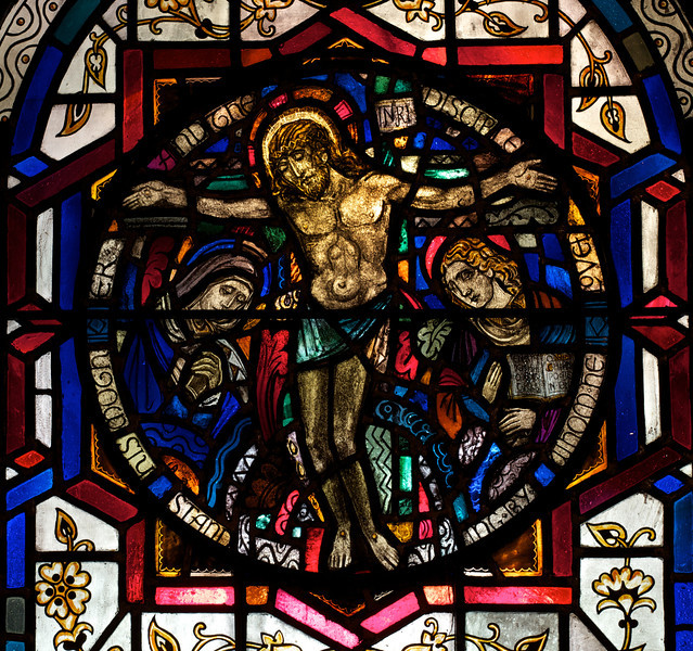 "Saint Bartholomew's Church, The Crucifixion Stained Glass Window by J. Gordon Guthrie <br><br> John Gordon Guthrie (1874–1961), a Scottish immigrant, known professionally as ""J. Gordon Guthrie"" designed this window. Guthrie had first designed windows for Tiffany Studios. He left Tiffany in 1906 and worked for Duffner & Kimberly until 1914. The New York City company produced leaded glass and bronze lamps at approximately the same time as Tiffany. He then worked with Henry Wynd Young (1874–1923) until Young's death in 1923, when Guthrie took over the management of Young's studio. Guthrie began his own firm in 1925, and was active as a stained glass designer until his death on June 23, 1961, according to <a href=""http://en.wikipedia.org/wiki/Duffner_and_Kimberly "">Wikipedia.</a>"