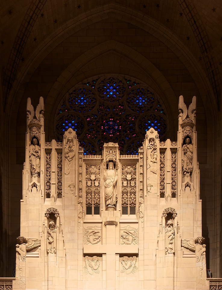 "Church of the Heavenly Rest Reredos and Rose Window <br><br> The focal point of the interior is the limestone reredos, designed by Earl N. Thorp and carved by Edward Ardolino, which rises 50 feet behind the altar and frames the rose window.  <br><br> John Gordon Guthrie (1874–1961), a Scottish immigrant, known professionally as ""J. Gordon Guthrie"" designed the rose window. Guthrie had first designed windows for Tiffany Studios. He left Tiffany in 1906 and worked for Duffner & Kimberly until 1914. The New York City company produced leaded glass and bronze lamps at approximately the same time as Tiffany. He then worked with Henry Wynd Young (1874–1923) until Young's death in 1923, when Guthrie took over the management of Young's studio. Guthrie began his own firm in 1925, and was active as a stained glass designer until his death on June 23, 1961, according to <a href=""http://en.wikipedia.org/wiki/Duffner_and_Kimberly "">Wikipedia.</a>"