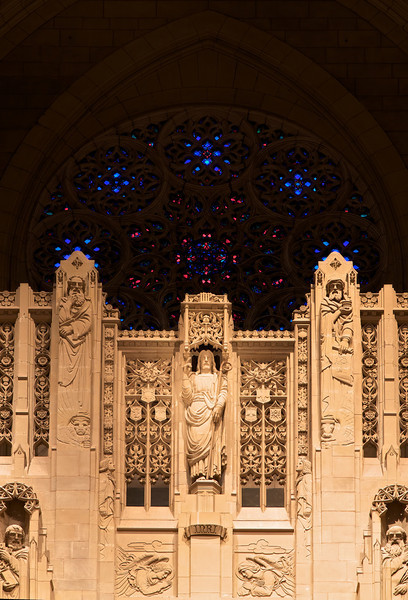 """Church of the Heavenly Rest Reredos and Rose Window <br><br> The focal point of the interior is the limestone reredos, designed by Earl N. Thorp and carved by Edward Ardolino, which rises 50 feet behind the altar and frames the rose window.  <br><br> John Gordon Guthrie (1874–1961), a Scottish immigrant, known professionally as """"J. Gordon Guthrie"""" designed the rose window. Guthrie had first designed windows for Tiffany Studios. He left Tiffany in 1906 and worked for Duffner & Kimberly until 1914. The New York City company produced leaded glass and bronze lamps at approximately the same time as Tiffany. He then worked with Henry Wynd Young (1874–1923) until Young's death in 1923, when Guthrie took over the management of Young's studio. Guthrie began his own firm in 1925, and was active as a stained glass designer until his death on June 23, 1961, according to <a href=""""http://en.wikipedia.org/wiki/Duffner_and_Kimberly """">Wikipedia.</a>"""