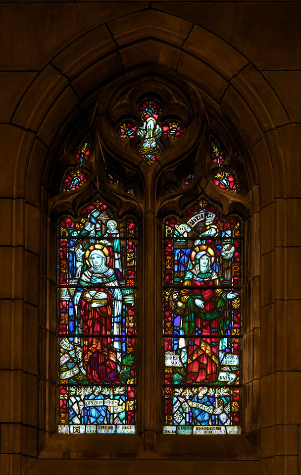 """Saint Thomas Church, Longsuffering and Peace (1930) Stained Glass Window by James Humphries Hogan of James Powell & Sons (Whitefriars), Ltd. <br><br> This window is in the Chantry Chapel also known as The Lady Chapel, which is dedicated to Our Lady, Saint Mary the Virgin. There are four windows in the chapel-all in honor of women in the Scriptures. One window was completed in 1929 and the other three in 1930. This window is Longsuffering and Peace. On the left side, which represents Longsuffering, is Dorca and Phebe represents Peace on the right side. The four windows were made possible by donations from the Burden family. Thanks to  David Daniel at Saint Thomas for information on the windows. <br><br> James Humphries Hogan (1883-1948) designed stained glass windows at Saint Thomas including this wondow. He was a noted stained glass artist for James Powell & Sons (Whitefriars), Ltd. of London from age 14 until his death in 1948. He made windows for many of England's churches including the 100 foot high central windows of Liverpool Cathedral. Some consider the windows at Saint Thomas to be some of the finest designs. <br><br> The firm of James Powell and Sons, also known as Whitefriars Glass, was an English glassmaker and stained glass window manufacturer. The company started in the 17th century but became well known as a result of the 19th century Gothic Revival. In 1962 the company name was changed back to Whitefriars Glass Ltd. It specialized in freeform glass ware until Caithness Glass purchased the firm in 1981. See <a href=""""http://en.wikipedia.org/wiki/James_Humphries_Hogan"""">Wikpedia</a> for more detail.  <br><br> In 2007, conservation began on the windows. It required three years and $20 million to restore the 9 million pieces of glass. The largest windows each required 4,500 man hours, the labor of one artisan for two and a half years. See the <a href=""""http://www.saintthomaschurch.org/about/glass"""">Saint Thomas website</a> and <a href=""""http://www.nytimes.com/2"""