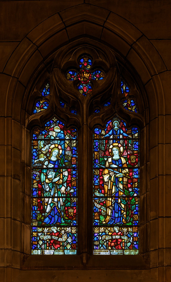 "Saint Thomas Church, Goodness and Gentleness (1930) Stained Glass Window by James Humphries Hogan of James Powell & Sons (Whitefriars), Ltd. <br><br> This window is in the Chantry Chapel also known as The Lady Chapel, which is dedicated to Our Lady, Saint Mary the Virgin. There are four windows in the chapel-all in honor of women in the Scriptures. One window was completed in 1929 and the other three in 1930. This window is Goodness and Gentleness. On the left side, which represents Goodness, is Saint Agnes and Saint Dorothy represents Gentleness on the right side. The four windows were made possible by donations from the Burden family. Thanks to  David Daniel at Saint Thomas for information on the windows. <br><br> James Humphries Hogan (1883-1948) designed stained glass windows at Saint Thomas including this wondow. He was a noted stained glass artist for James Powell & Sons (Whitefriars), Ltd. of London from age 14 until his death in 1948. He made windows for many of England's churches including the 100 foot high central windows of Liverpool Cathedral. Some consider the windows at Saint Thomas to be some of the finest designs. <br><br> The firm of James Powell and Sons, also known as Whitefriars Glass, was an English glassmaker and stained glass window manufacturer. The company started in the 17th century but became well known as a result of the 19th century Gothic Revival. In 1962 the company name was changed back to Whitefriars Glass Ltd. It specialized in freeform glass ware until Caithness Glass purchased the firm in 1981. See <a href=""http://en.wikipedia.org/wiki/James_Humphries_Hogan"">Wikpedia</a> for more detail.  <br><br> In 2007, conservation began on the windows. It required three years and $20 million to restore the 9 million pieces of glass. The largest windows each required 4,500 man hours, the labor of one artisan for two and a half years. See the <a href=""http://www.saintthomaschurch.org/about/glass"">Saint Thomas website</a> and <a href=""http://www.nytimes.com/2008/04/15/arts/design/15stai.html?_r=1&ref=arts&oref=slogin"">a New York Times article</a> for more detail."