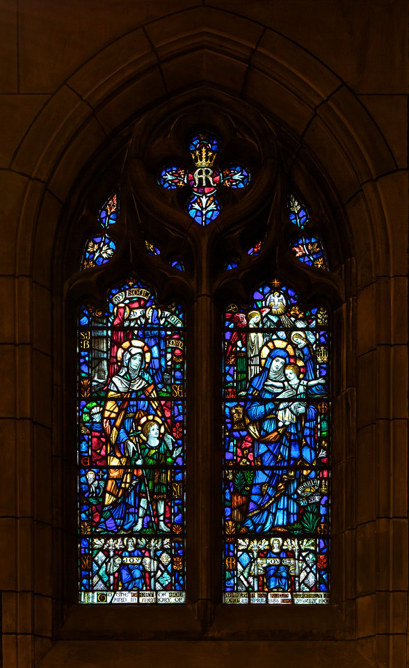 """Saint Thomas Church, Joy and Love (1929) Stained Glass Window by James Humphries Hogan of James Powell & Sons (Whitefriars), Ltd. <br><br> This window is in the Chantry Chapel also known as The Lady Chapel, which is dedicated to Our Lady, Saint Mary the Virgin. There are four windows in the chapel-all in honor of women in the Scriptures. One window was completed in 1929 and the other three in 1930. This window is Joy and Love, which is closest to the altar. On the left side, which represents Joy, is Saint Elizabeth with her son John the Baptist and Saint Mary the Virgin holding Christ represents Love on the right side. The four windows were made possible by donations from the Burden family. Thanks to  David Daniel at Saint Thomas for information on the windows. <br><br> James Humphries Hogan (1883-1948) designed stained glass windows at Saint Thomas including this wondow. He was a noted stained glass artist for James Powell & Sons (Whitefriars), Ltd. of London from age 14 until his death in 1948. He made windows for many of England's churches including the 100 foot high central windows of Liverpool Cathedral. Some consider the windows at Saint Thomas to be some of the finest designs. <br><br> The firm of James Powell and Sons, also known as Whitefriars Glass, was an English glassmaker and stained glass window manufacturer. The company started in the 17th century but became well known as a result of the 19th century Gothic Revival. In 1962 the company name was changed back to Whitefriars Glass Ltd. It specialized in freeform glass ware until Caithness Glass purchased the firm in 1981. See <a href=""""http://en.wikipedia.org/wiki/James_Humphries_Hogan"""">Wikpedia</a> for more detail.  <br><br> In 2007, conservation began on the windows. It required three years and $20 million to restore the 9 million pieces of glass. The largest windows each required 4,500 man hours, the labor of one artisan for two and a half years. See the <a href=""""http://www.saintthomaschurch.org/about/"""