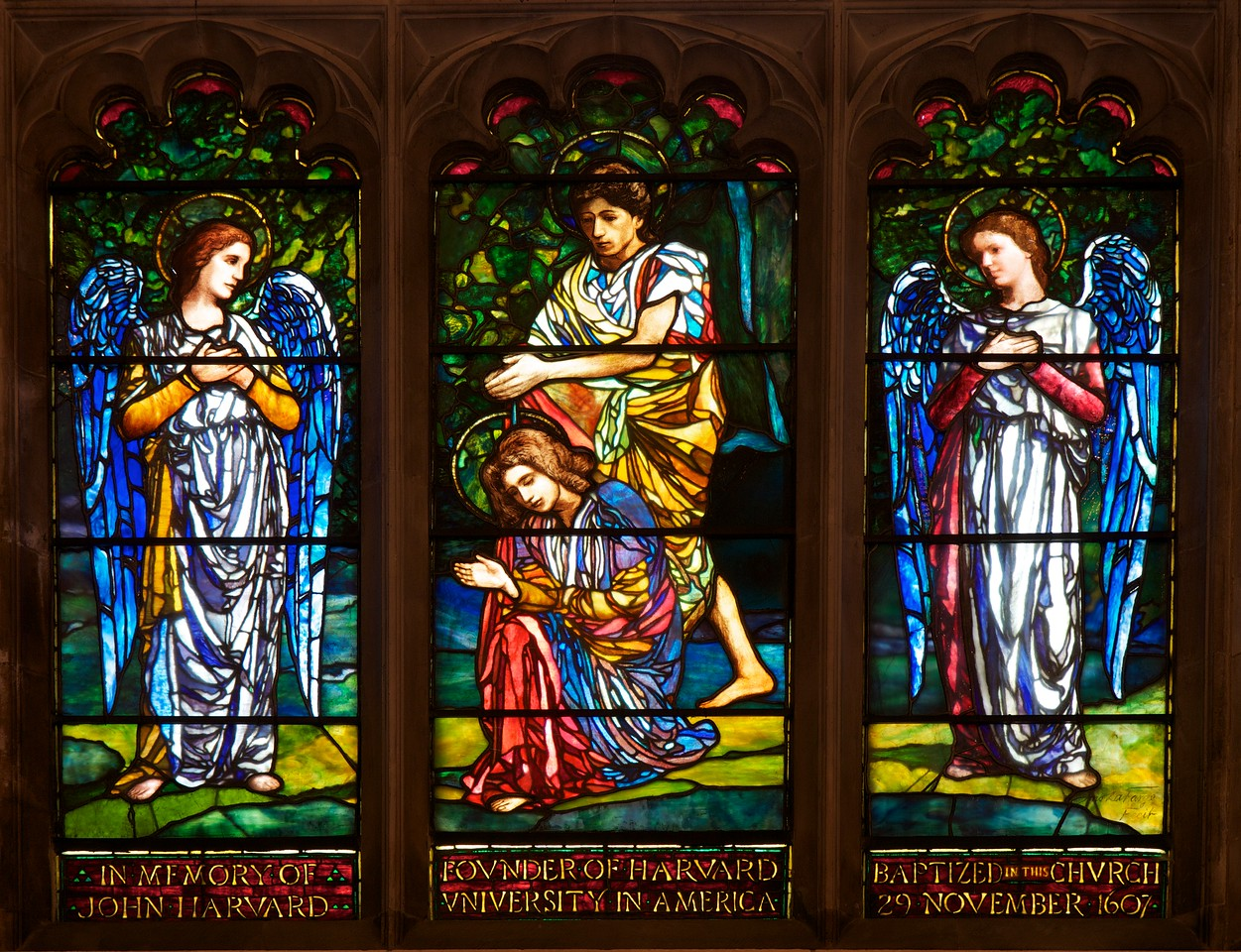"Southward Cathedral, Harvard Chapel Stained Glass Window by John LaFarge <br><br> Founder of Harvard University John Harvard was born in near the church in Southwark. His father was a business associate of Shakespeare's family and Shakespeare is believed to have been present when John was baptized in the church in 1607, according to <a href=""http://www.sacred-destinations.com/england/london-southwark-cathedral"">Sacred Destinations.</a> <br><br> John Harvard is commemorated in the church by the Harvard Chapel, off the North Transept, restored with funds received from members of Harvard University. John was educated at Emmanuel College, Cambridge and graduated in 1635. ""The following year he married Anne Sadler and having no relatives left in Southwark, decided to join his brother Puritans to form a godly commonwealth in the New World. <br><br> Arriving in Boston, with his library of 320 volumes, Harvard was admitted a townsman of Charlestown and ministered in the 'First Church'. He was described as a scholar and lover of learning. He died childless in 1638. He left his books (of which only one remains) and half his fortune, £779 17s 2d, to the college of Newtown, a foundation for the 'education of English and Indian youth in knowledge and godliness'. Newtown became Cambridge, Massachusetts and the college became Harvard University"" <a href=""http://cathedral.southwark.anglican.org/visit/area-2"">according to the church website.</a> <br><br> Two panels of stained glass windows are the highlight of the chapel. The first is a window given by the then American Ambassador to London, Joseph Choate, in 1905.  Depicting the baptism of Christ by John the Baptist, it is by American artist John La Farge. It uses a technique of mixing several colors in one piece of opalescent glass. The second shows the Harvard crest (Veritas, Latin for ""Verity"" or ""Truth"") and Emmanual College, Cambridge with an inscription ""This Window, Damaged During World War 2 By Enemy Bombing, Was Restored In 1948 Through The Generosity of Harvard Alumni In The United States of America."" I don't know the artist that created the window."