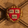 "Southward Cathedral, Harvard Chapel Crest Veritas, Latin for ""Verity"" or ""Truth"" <br><br> Founder of Harvard University John Harvard was born in near the church in Southwark. His father was a business associate of Shakespeare's family and Shakespeare is believed to have been present when John was baptized in the church in 1607, according to <a href=""http://www.sacred-destinations.com/england/london-southwark-cathedral"">Sacred Destinations.</a> <br><br> John Harvard is commemorated in the church by the Harvard Chapel, off the North Transept, restored with funds received from members of Harvard University. John was educated at Emmanuel College, Cambridge and graduated in 1635. ""The following year he married Anne Sadler and having no relatives left in Southwark, decided to join his brother Puritans to form a godly commonwealth in the New World. <br><br> Arriving in Boston, with his library of 320 volumes, Harvard was admitted a townsman of Charlestown and ministered in the 'First Church'. He was described as a scholar and lover of learning. He died childless in 1638. He left his books (of which only one remains) and half his fortune, £779 17s 2d, to the college of Newtown, a foundation for the 'education of English and Indian youth in knowledge and godliness'. Newtown became Cambridge, Massachusetts and the college became Harvard University <a href=""http://cathedral.southwark.anglican.org/visit/area-2"">according to the church website.</a>"