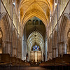 "Southwark Cathedral Nave <br><br> Southwark Cathedral in Southwark, London, is on the south bank of the River Thames near the London Bridge. It is the mother church of the Anglican Diocese of Southwark and has been a place of Christian worship for more than 1,000 years, according to <a href=""http://en.wikipedia.org/wiki/Southwark_Cathedral"">Wikipedia.</a>  <br><br> Prior to the church, the site was a Roman villa, according to the <a href=""http://www.southwark.anglican.org/cathedral/tour/history1.htm"">Southwark website.</a>  In 1977, a pagan statue from the fourth century was discovered beneath the church.  <br><br> ""The present building retains the basic form of the Gothic structure built between 1220 and 1420, although the nave is a late 19th-century reconstruction. <br><br> The Great Fire of 1212 badly damaged the church. Only a few traces of the Norman church remain today, including a doorway in the north side of the nave. ""Rebuilding took place during the thirteenth century, although the exact dates are unknown. In its reconstructed state - the basic layout of which survives today - the church was cruciform in plan, with an aisled nave of six bays, a crossing tower, transepts, and a five bay choir,"" according to Wikipedia.  <br><br> ""In the 1390s, the church was again damaged by fire, and in around 1420 the Bishop of Winchester Henry Beaufort, assisted with the rebuilding of the south transept and the completion of the tower. During the 15th century the parochial chapel was rebuilt, and the nave and north transept were given wooden vaults following the collapse of the stone ceiling in 1469. Some of the carved bosses from the vault (destroyed in the 19th century) are preserved in the cathedral."" <br><br> William Shakespeare and Geoffrey Chaucer worshipped at Southwark Cathedral. Shakespeare is believed to have been present when John Harvard, founder of the American university, was baptized here in 1607 according to <a href=""http://www.sacred-destinations.com/england/london-southwark-cathedral"">Sacred Destinations</a>"