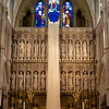 "Southwark Cathedral Screen and Reredos <br><br> Bishop Fox of Winchester erected the screen and reredos in 1520. Although the general appearance of the screen, with three broad rich bands of carvings and statuary, is that of the original, most of the detail is from later periods, according to <a href=""http://cathedral.southwark.anglican.org/visit/area-3"">according to the church website.</a> <br><br> ""Whether all the original statues were ever installed is uncertain, as the screen was completed within a decade of the Reformation when such statues were forbidden. The small carvings of the Lamb of God and the pelican (a badge of Bishop Fox) immediately above the rows of angels are probably original, as are some of the bases of the niches. The small carvings in the corners of the two doorways, showing hunting scenes, may also be original."" <br><br> In 1703 the screen was concealed by a painted wooden screen with the Lord's Prayer, Creed, the Ten Commandments, a dove descending with a group of cherubs 'heads' and topped with flaming urns. This screen was removed in 1833, and the niches restored and three rows of carved angels added. The statues were added from 1905 onwards and depict people with an historical connection to Southwark."" <br><br> The hanging wool strands are an installation called '40 days' from artist <a href=""http://www.countrysideonline.co.uk/the-magazine/countryside-xtra/woolly-wonders-angela-wright-artist-in-wool/"">Angela Wright</a>   during Lent 2014. Her installation is made of wool from 40 different countries."