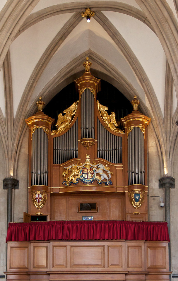 """Temple Church Organ <br><br> Harrison & Harrison Ltd built and installed the great organ in 1954. The case, behind which is the four manual organ complete with three 32-ft stops, is modeled on drawings of the Temple's Father Smith organ of 1688. <br><br> """"From 1683 (the year Father Smith and Renatus Harris were commissioned to compete for the contract to install an organ in the Temple Church), the instruments have been well documented. However, the earliest mention of an organ in the Temple Church appears in an inventory made by the Sheriffs of London in 1307 which mentions that there were In the Great Church 'Two pairs of organs and in the quire a book for the organs and two cushions for the chanter's chairs'""""  according to <a href=""""http://www.templechurch.com/music/the-organ/"""">the church website. </a> The organ was restored from 2011-2013. <a href=""""http://www.templechurch.com/organ-appeal/"""">Queen Elizabeth</a> attended the dedication ceremony."""