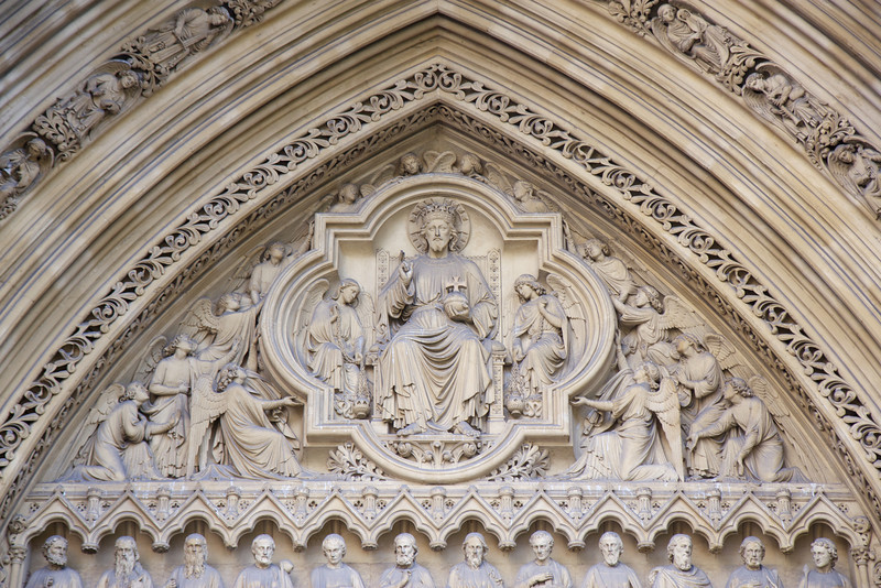 "Westminster Abbey North Entrance <br><br> Westminster Abbey is a Gothic church located west of the Palace of Westminster. A church was founded on the site in the 7th century; construction on the present church began in 1245 on the orders of Henry III, who wanted the site for his burial. Work continued between 1245 and 1517 and was finished during the reign of Richard II. Until the death of George II in 1760, most kings and queens were buried in the abbey. Geoffrey Chaucer was buried there and other poets, writers, and musicians were buried around Chaucer in what is known as Poets' Corner. Isaac Newton and Charles Darwin are also buried there. See <a href=""http://en.wikipedia.org/wiki/Westminster_Abbey"">Wikipedia</a> for more detail."