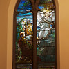 """The Second Reformed Church Christ, The Three Marys at the Tomb Window <br><br> From <a href=""""http://www.secondreformed.org/stainedglass"""">the church website:</a> <br><br> """"Observe how the angel radiates light that illuminates the scene. The artist captures effect of the light on the hair of the women. Artists strive to achieve this look on canvas with a brush and a variety of paints. Here there has been no application of paint.  The streaks of color within the glass give the appearance of strands of hair.  This utilization of Tiffany glass is particularly beautiful  on the kneeling women. Note the plated glass effects. Plating is a method of building layers to modulate the light coming through to achieve special effects and colors. A large piece of glass was layered over the top of leaded pieces that make up part of the rocks. Used here, the plating helps to diminish the importance of the rocks in the design.  The viewer instead focuses on the figures. A metal bar was designed to conform to the head of the angel, thus providing the necessary structural support and enhancing the overall design. Imagine how a straight support bar crossing the angel's head would have interfered with the beauty of this work."""" <br><br> Louis Comfort Tiffany (1848-1933) was one of America's most acclaimed artists and is most associated with the Art Nouveau and Aesthetic movements according to <a href=""""http://en.wikipedia.org/wiki/Louis_Comfort_Tiffany"""">Wikipedia.</a> He focused in the decorative arts and is best known for his work in stained glass. He was the son of Charles Lewis Tiffany (1812-1902), founder of Tiffany & Company. Lewis chose to pursue his own artistic interests rather than joining the family business.  <br><br> He began his career as a painter and traveled extensively through Europe. In the late 1870s, Tiffany turned his attention to decorative arts and interiors. In 1881, he did the interior design of the Mark Twain House in Hartford Connecticut. His most notable work was"""