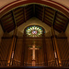 "The Second Reformed Church Rose Window <br><br> From <a href=""http://www.secondreformed.org/stainedglass"">the church website</a> <br><br> ""When our current building was built, Tiffany was commissioned to create this beautiful window which is very interactive during morning worship. Sometimes the deep olive green predominates. Some days a beautiful blue is seen at the outer edge. Other days when the sunlight strikes it directly, it is golden and so radiant that the star in the center is not able to be seen. <br><br> The Metropolitan Museum of Art noted at the time of the installation in 1909, ""...under the personal supervision of Mr. Louis C. Tiffany, has been placed in the Church-'a magnificent Rose Window containing a jeweled cross, extending through many openings in the circle with an illuminated background representing the sky'""."" <br><br> Below the window is the 38 rank Austin pipe organ, installed in 1978.  <br><br> Louis Comfort Tiffany (1848-1933) was one of America's most acclaimed artists and is most associated with the Art Nouveau and Aesthetic movements according to <a href=""http://en.wikipedia.org/wiki/Louis_Comfort_Tiffany"">Wikipedia.</a> He focused in the decorative arts and is best known for his work in stained glass. He was the son of Charles Lewis Tiffany (1812-1902), founder of Tiffany & Company. Lewis chose to pursue his own artistic interests rather than joining the family business.  <br><br> He began his career as a painter and traveled extensively through Europe. In the late 1870s, Tiffany turned his attention to decorative arts and interiors. In 1881, he did the interior design of the Mark Twain House in Hartford Connecticut. His most notable work was in 1862 when President Chester Arthur refused to move into the White House until it had been resorted, according to Wikipedia. He commissioned Tiffany, who had begun to make a name for himself for interior design work, to redo the state rooms. Tiffany worked on the East Room, Blue Room, Red Room, the State Dining Room, and the Entrance Hall.  <br><br> From  <a href=""http://www.metmuseum.org/toah/hd/tiff/hd_tiff.htm"">The Metropolitan Museum website:</a> ""By late 1892 or early 1893, Tiffany built a glasshouse in Corona, Queens, New York, and, with Arthur Nash, a skilled glassworker from Stourbridge, England, his furnaces developed a method whereby different colors were blended together in the molten state, achieving subtle effects of shading and texture. Recalling the Old English word fabrile (hand-wrought), Tiffany named the blown glass from his furnaces Favrile, a trademark that signified glass of hand-made and unique quality."" <br><br> ""Of all of Tiffany's artistic endeavors, leaded-glass brought him the greatest recognition. Tiffany and his early rival, John La Farge, revolutionized the look of stained glass, which had remained essentially unchanged since medieval times when craftsmen utilized flat panes of white and colored glass with details painted with glass paints before firing and leading. Tiffany and La Farge experimented with new types of glass and achieved a more varied palette with richer hues and greater density. By 1881, each had patented an opalescent glass, a unique American phenomenon that featured a milky, opaque, and sometimes rainbow-hued appearance with the introduction of light. Internally colored with variegated shades of the same or different hues, Tiffany's Favrile glass enabled craftsmen to substitute random tonal gradations, lines, textures, and densities inherent in the material itself for pictorial details."" <br><br> At its peak, his factory employed over 300 artisans. He was appointed as art director at Tiffany & Company upon his father's death in 1902. <br><br> Tiffany lived during the Gilded Age, a period of rapid church expansion; one source reports that there were 4,000 churches under contraction in the U.S. in the 1880s according to a recent <a href=""http://www.nytimes.com/2013/01/01/arts/design/louis-c-tiffany-works-at-museum-of-biblical-art.html?ref=louiscomforttiffany"">The New York Times article</a> on an exhibit of Tiffany's ecclesiastical work. There was a great demand for artists that could create great and inspiring stained glass windows, mosaics, rederos, and altars. Many churches turned to Tiffany to create such beautiful works. His work in New York churches include Saint Michaels, Advent Lutheran, Saint Ignatius Loyola, Temple Emmanu-El, Church of the Incarnation, Holy Trinity Lutheran Church, Eldridge Street Synagogue; in New Jersey, numerous windows are in Second Reformed Church of Hackensack. <br><br> After fire destroyed their first church, The Second Reform Church in Hackensack, New Jersey contacted Tiffany requesting windows depicting events in the life of Christ and contracted Tiffany Studios for five windows, according to <a href=""http://www.secondreformed.org/clientimages/42874/stainedglasswindows/stained%20glass%20window%20info.pdf"">the church website.</a> The church also contracted Duffner & Kimberly Co. for one window.  The installation of these windows was competed before the dedication ceremony in 1909.  <br><br> From the church website: <br><br> ""The New York Times (May 4, 1979) wrote: ""Some of Tiffany's favorite windows are in the Second Reformed Church in Hackensack ,... Tiffany frequently visited there with clients in tow, using  the visit to help them select appropriate design for their purposes."" For each installation, the design was customized as the client requested and reworked to fit the window's opening size and shape requirements. Colors were coordinated to harmonize with the surroundings in each location."""