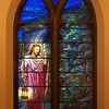 "The Second Reformed Church Christ, Christ, Knocking at the Door Window <br><br> From <a href=""http://www.secondreformed.org/stainedglass"">the church website:</a> <br><br> ""Our hearts need to be opened to let Jesus enter. The lantern Jesus carries is symbolic of His being the Light of the World. This lantern radiates its light on the darkest day!  <br><br> This was a very popular theme of the period and Tiffany Studios installed many windows similar to this one. The studios utilized this basic design concept and customized it for other churches. A variation was the addition of a crown to Jesus' head. Colors would have been coordinated to harmonize with the surroundings in each location."" <br><br> Louis Comfort Tiffany (1848-1933) was one of America's most acclaimed artists and is most associated with the Art Nouveau and Aesthetic movements according to <a href=""http://en.wikipedia.org/wiki/Louis_Comfort_Tiffany"">Wikipedia.</a> He focused in the decorative arts and is best known for his work in stained glass. He was the son of Charles Lewis Tiffany (1812-1902), founder of Tiffany & Company. Lewis chose to pursue his own artistic interests rather than joining the family business.  <br><br> He began his career as a painter and traveled extensively through Europe. In the late 1870s, Tiffany turned his attention to decorative arts and interiors. In 1881, he did the interior design of the Mark Twain House in Hartford Connecticut. His most notable work was in 1862 when President Chester Arthur refused to move into the White House until it had been resorted, according to Wikipedia. He commissioned Tiffany, who had begun to make a name for himself for interior design work, to redo the state rooms. Tiffany worked on the East Room, Blue Room, Red Room, the State Dining Room, and the Entrance Hall.  <br><br> From  <a href=""http://www.metmuseum.org/toah/hd/tiff/hd_tiff.htm"">The Metropolitan Museum website:</a> ""By late 1892 or early 1893, Tiffany built a glasshouse in Corona, Queens, New York, and, with Arthur Nash, a skilled glassworker from Stourbridge, England, his furnaces developed a method whereby different colors were blended together in the molten state, achieving subtle effects of shading and texture. Recalling the Old English word fabrile (hand-wrought), Tiffany named the blown glass from his furnaces Favrile, a trademark that signified glass of hand-made and unique quality."" <br><br> ""Of all of Tiffany's artistic endeavors, leaded-glass brought him the greatest recognition. Tiffany and his early rival, John La Farge, revolutionized the look of stained glass, which had remained essentially unchanged since medieval times when craftsmen utilized flat panes of white and colored glass with details painted with glass paints before firing and leading. Tiffany and La Farge experimented with new types of glass and achieved a more varied palette with richer hues and greater density. By 1881, each had patented an opalescent glass, a unique American phenomenon that featured a milky, opaque, and sometimes rainbow-hued appearance with the introduction of light. Internally colored with variegated shades of the same or different hues, Tiffany's Favrile glass enabled craftsmen to substitute random tonal gradations, lines, textures, and densities inherent in the material itself for pictorial details."" <br><br> At its peak, his factory employed over 300 artisans. He was appointed as art director at Tiffany & Company upon his father's death in 1902. <br><br> Tiffany lived during the Gilded Age, a period of rapid church expansion; one source reports that there were 4,000 churches under contraction in the U.S. in the 1880s according to a recent <a href=""http://www.nytimes.com/2013/01/01/arts/design/louis-c-tiffany-works-at-museum-of-biblical-art.html?ref=louiscomforttiffany"">The New York Times article</a> on an exhibit of Tiffany's ecclesiastical work. There was a great demand for artists that could create great and inspiring stained glass windows, mosaics, rederos, and altars. Many churches turned to Tiffany to create such beautiful works. His work in New York churches include Saint Michaels, Advent Lutheran, Saint Ignatius Loyola, Temple Emmanu-El, Church of the Incarnation, Holy Trinity Lutheran Church, Eldridge Street Synagogue; in New Jersey, numerous windows are in Second Reformed Church of Hackensack. <br><br> After fire destroyed their first church, The Second Reform Church in Hackensack, New Jersey contacted Tiffany requesting windows depicting events in the life of Christ and contracted Tiffany Studios for five windows, according to <a href=""http://www.secondreformed.org/clientimages/42874/stainedglasswindows/stained%20glass%20window%20info.pdf"">the church website.</a> The church also contracted Duffner & Kimberly Co. for one window.  The installation of these windows was competed before the dedication ceremony in 1909.  <br><br> From the church website: <br><br> ""The New York Times (May 4, 1979) wrote: ""Some of Tiffany's favorite windows are in the Second Reformed Church in Hackensack ,... Tiffany frequently visited there with clients in tow, using  the visit to help them select appropriate design for their purposes."" For each installation, the design was customized as the client requested and reworked to fit the window's opening size and shape requirements. Colors were coordinated to harmonize with the surroundings in each location."""