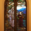 """The Second Reformed Church The Good Shepherd Window <br><br> From <a href=""""http://www.secondreformed.org/stainedglass"""">the church website:</a> <br><br> """"Please look carefully at the grain in the wooden staff, the bark of the tree, the rich colors in the folds of the garments, as well as the thickness variations of the drapery  glass. Remember every piece of glass was planned for and created to be used in that specific place in this particular window. There is no lead separating the sky and mountain. This helps the mountain recede into the distance."""" <br><br> Louis Comfort Tiffany (1848-1933) was one of America's most acclaimed artists and is most associated with the Art Nouveau and Aesthetic movements according to <a href=""""http://en.wikipedia.org/wiki/Louis_Comfort_Tiffany"""">Wikipedia.</a> He focused in the decorative arts and is best known for his work in stained glass. He was the son of Charles Lewis Tiffany (1812-1902), founder of Tiffany & Company. Lewis chose to pursue his own artistic interests rather than joining the family business.  <br><br> He began his career as a painter and traveled extensively through Europe. In the late 1870s, Tiffany turned his attention to decorative arts and interiors. In 1881, he did the interior design of the Mark Twain House in Hartford Connecticut. His most notable work was in 1862 when President Chester Arthur refused to move into the White House until it had been resorted, according to Wikipedia. He commissioned Tiffany, who had begun to make a name for himself for interior design work, to redo the state rooms. Tiffany worked on the East Room, Blue Room, Red Room, the State Dining Room, and the Entrance Hall.  <br><br> From  <a href=""""http://www.metmuseum.org/toah/hd/tiff/hd_tiff.htm"""">The Metropolitan Museum website:</a> """"By late 1892 or early 1893, Tiffany built a glasshouse in Corona, Queens, New York, and, with Arthur Nash, a skilled glassworker from Stourbridge, England, his furnaces developed a method whereby different col"""