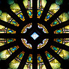 """The Second Reformed Church Rose Window <br><br> From <a href=""""http://www.secondreformed.org/stainedglass"""">the church website</a> <br><br> """"When our current building was built, Tiffany was commissioned to create this beautiful window which is very interactive during morning worship. Sometimes the deep olive green predominates. Some days a beautiful blue is seen at the outer edge. Other days when the sunlight strikes it directly, it is golden and so radiant that the star in the center is not able to be seen. <br><br> The Metropolitan Museum of Art noted at the time of the installation in 1909, """"...under the personal supervision of Mr. Louis C. Tiffany, has been placed in the Church-'a magnificent Rose Window containing a jeweled cross, extending through many openings in the circle with an illuminated background representing the sky'""""."""" <br><br> Louis Comfort Tiffany (1848-1933) was one of America's most acclaimed artists and is most associated with the Art Nouveau and Aesthetic movements according to <a href=""""http://en.wikipedia.org/wiki/Louis_Comfort_Tiffany"""">Wikipedia.</a> He focused in the decorative arts and is best known for his work in stained glass. He was the son of Charles Lewis Tiffany (1812-1902), founder of Tiffany & Company. Lewis chose to pursue his own artistic interests rather than joining the family business.  <br><br> He began his career as a painter and traveled extensively through Europe. In the late 1870s, Tiffany turned his attention to decorative arts and interiors. In 1881, he did the interior design of the Mark Twain House in Hartford Connecticut. His most notable work was in 1862 when President Chester Arthur refused to move into the White House until it had been resorted, according to Wikipedia. He commissioned Tiffany, who had begun to make a name for himself for interior design work, to redo the state rooms. Tiffany worked on the East Room, Blue Room, Red Room, the State Dining Room, and the Entrance Hall.  <br><br> From  <a href=""""http://w"""