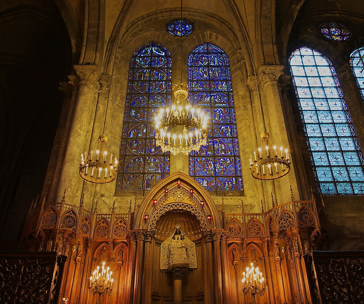 """Chartres Cathedral Our Lady of the Pillar  <br><br> This is the Chapel of Notre Dame de Pilar (Our Lady of the Pillar) in the north ambulatory. According to <a href=""""http://professor-moriarty.com/info/section/sculpture/gothic-sculpture-black-madonna-chartres-cathedral"""">Professor Moriarty,</a> the statue in the center is of Madonna and child and was commissioned in 1508 as a black wooden copy of the 13th century silver Madonna that once stood on the main altar at Chartres Cathedral. """"This statue was later given to the Cathedral in about 1540. The statue currently sits on top of a pillar in the North aisle of the cathedral and is commonly known as """"Our Lady of the Pillar"""". Chartres was a centre for the Marian cult and, in addition to the Blue Virgin stained glass window in the south ambulatory, also had another 11th century wooden Madonna statue in the crypt. That statue was burned during the French revolution, and for some time this Madonna was put there, until a copy of the original was made in 1857."""" Professor Moriarty also has close-up photos of the Madonna."""