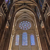 Chartres West Rose Window <br><br> Chartres cathedral is currently undergoing a renovation that started in 2008 and will continue through 2015 at a cost of $350 million. As of 2011, two major chapels-Martyrs and the Apostles have been restored. One source says that 160,000 square feet of original plasterwork is now visible, returned to its 13th century glory. This photo shows the contrast between the newly renovated walls and the walls with 800 years of dirt, grit, smoke, soot. The West Rose window from the 13th century depicts the Last Judgment. The Jessee Window is at bottom right, the Passion Window is at bottom left, and the Life of Christ Window is bottom center. The bottom windows date from around 1150.