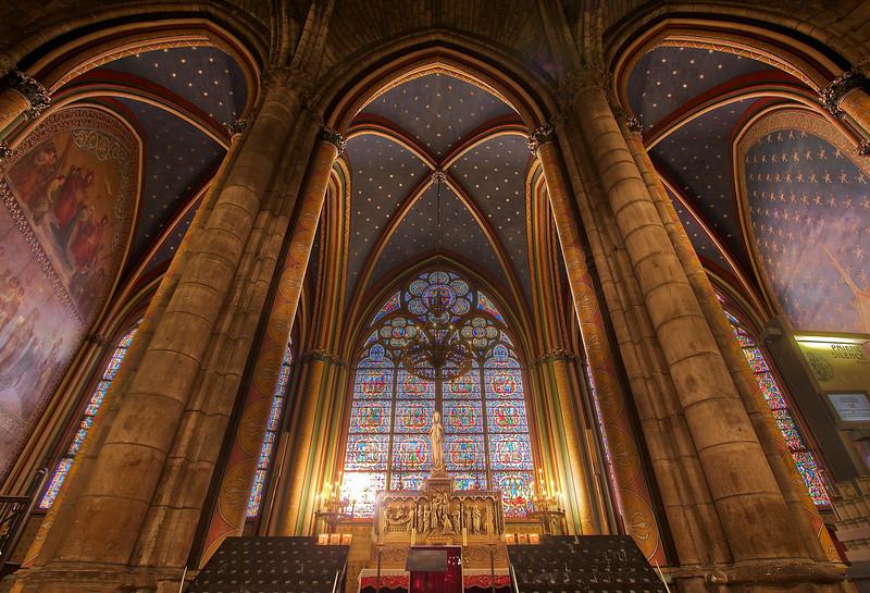 Notre Dame<br /> <br /> I couldn't find any information on two beautiful small contiguous chapels in the back of the church (see next photo). Can anybody help? I did not employ HDR on this photo; I liked the properly exposed print but it had one problem-the early morning sun overexposed the stained glass windows. To correct for this, I used the properly exposed photo and created a layer mask consisting of the underexposed windows that had more color and detail. Essentially, I cut the windows from the underexposed print and pasted on to the properly exposed version. The final product is very consistent with how it looked when I was there on an early morning in March.