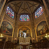 "Saint-Eustache Chapel of the Virgin Mary <br><br> At the rear of the church is the Chapel of the Virgin Mary. Striking features of the gold-toned chapel are three frescos, a stature of Mary in the middle of the alter, and beautiful stained glass windows above. I was there one late Saturday afternoon in March 2012 and was lucky to catch a beam of sunlight through a window that highlighted the statue. From church tourist information: ""In the morning and evening twilight's so suitable to prayer rises to the heights of the ambulatory the Chapel of the Virgin Mary. Thomas Couture (1856-Master of Edouard Manet), painted the frescoes that represent the power of intercession of the Virgin. On the alter, the graceful stature of the Virgin (1748), originally carved for the Chapel of the Invalides by Pigalle."" Pigalle's name is most commonly known because of the Pigalle red-light district in Paris.  <br><br> I did not use HDR because I liked the single properly exposed photo (f6.3, 1.6 seconds, 100 ISO); because the above windows were clipped, I selected and pasted windows from the underexposed shot and blended the two to provide more detail and color in the windows."