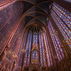 "Sainte-Chapelle <br><br> The stained glass windows of the Upper Chapel of Sainte-Chapelle (The Holy Chapel) are amazing, particularly on a sunny day with light radiating through the windows. Unlike any church structure I have seen, stained glass windows mostly cover the Upper Chapel, covering a total of 6,500 square feet in area, of which two-thirds are still 13th century originals. The Western Rose window was crafted in the 15th century. Visitors marvel and stare in awe of the tall windows and statues of the twelve apostles. While admiring the spectacular art work I wondered what was this was used for? Was it a church? A house of worship? It is not listed in a helpful guide to Paris churches Patrimoine religieux de Paris, guide des visites de'eglises 2012 so I wasn't sure.  <br><br> The answer is that the building, built from 1242-1258 by King Louis IX, was designed to house the relics of Christ's Passion, particularly, the Crown of Thorns. The Upper Chapel housed the relics and was reserved for the king, family, and friends. According to <a href=""http://www.sacred-destinations.com/france/paris-sainte-chapelle"">Sacred Destinations</a>, Louis IX was unique among aristocrats in that he actually bought sacred relics rather than steal them. Much of the chapel as it appears today is a re-creation, although nearly two-thirds of the windows are authentic. The chapel suffered substantial damage during the French Revolution. Some parts of the chapel disappeared altogether, precious relics were scattered or melted down, some never found again. The few recovered relics are now at Notre-Dame. Sainte-Chapelle was renovated under the direction of Eugène Viollet-le-Duc. He renovated Notre Dame and many other churches. The renovation was highly regarding by critics and is faithful to the original drawings and descriptions of the chapel that survive. The windows were removed two times and painstakingly reinstalled: during the 19th century and during World War II. <br><br> For 360 panorama views, see <a href=""http://mappinggothic.org/building/1168"">Mapping Gothic France.</a> <br><br> I forgot my Joby GorillaPod on my visit to Sainte Chapelle; I'm not sure if the church allows tripods anyway. I bracketed my shots from -2 to +2 using 800 ISO with shutter speeds ranging from 1/400 to 1/25. The light at Sainte-Chapelle is adequate when the sun is shining, better than most churches so hand held shots are possible. Hand held, I take a lot of shots; for me holding my camera steady at shutter speeds of under 1/100 is hit or miss, generally more miss than hit. Post production, I selected the in focus exposures and used HDR to bring out the detail."