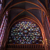 "Sainte-Chapelle Rose Window <br><br> From <a href=""http://architecture.relig.free.fr/chapelle_en.htm"">Religious Architecture</a>, the 16th century stained glass rose window is noteworthy as some of the colors, especially green, can't be found in other 13th century stained glass. The rose shows the Apocalypse around an enthroned Christ in the central oculus."