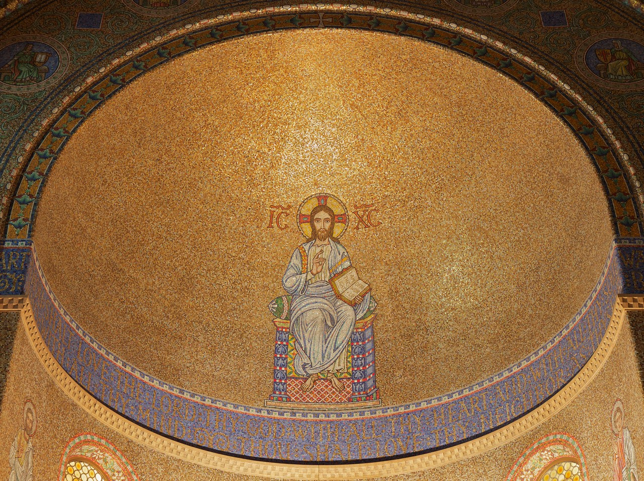 """Christ Church Apse and Nave<br /> <br /> From """"A Tour of Christ Church:""""<br /> <br /> """"The apse is decorated with mosaics, which are formed from tesserae. Tesserae are cubes of glass or vitreous enamel set in mastic or cement at uneven angles so that they reflect the light in a sparkling manner. There are said to be seven million tesserae in Christ Church. One's eye is drawn to the figure of Christ in the apse, and the use of gold leaf for the background adds richness and depth. This representation is known as Christ Pantocratur. Pantocratur is a Greek word meaning """"all powerful"""" and representations of Christ Pantocratur are widely used in Eastern Orthodox churches. Christ is portrayed as King and He is clad in the robes of a Byzantine Emperor. The bands on His shoulders are part of the imperial insignia and He is seated on the imperial throne. His right hand is raised in blessing – the Eastern style of blessing is used – and His left hand holds the Gospel of St. John, open at the text """"I am the light of the world"""" (John 8:12). On either side of His head are the letters IC_XC_ transliterated from the Greek, and this is an abbreviation for Jesus Christ. The surrounding tesserae are cunningly set so that the figure of Christ is bathed in light.<br /> <br /> Immediately below the figure of Christ is a curved band of blue with gold lettering. The text is from Matthew 22:27 and 39, and reads """"Thou shalt love the Lord with all thy heart and with all thy soul and with all thy mind. Thou shalt love thy neighbor as thyself.""""<br /> <br /> Surrounding the apse is a semi-circular band with seven medallions, each showing a figure holding a shield. This is a rather idiosyncratic interpretation of the seven gifts of the Holy Spirit, and the symbols on the shields, reading from left to right are: the Sun for understanding, a Book for counsel, a Lion for fortitude, a Dove for wisdom, a Lamp for knowledge, a Cross for piety and a Crown for spiritual reward. <br /> Below this band on """