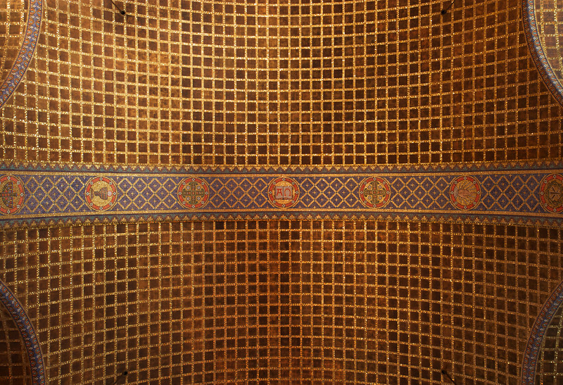 "Christ Church Barrel Vault Ceiling<br /> <br /> From ""A Tour of Christ Church:""<br /> <br /> ""Continuing with the mosaic symbols, you can look up and see there are three bands of nine symbols across the barrel vault. The same nine symbols are used in varying order in each of the bands and they include: the Alpha and Omega (the beginning and the end), the Hand of God, the Lamp of Knowledge, the Dove of the Holy Spirit and the Starry Crown of Spiritual Renewal. The vault is lined with acoustic tiles, whose fine aggregate coating serves to diffuse the sound and eliminate echoes when the church's excellent choir sings on Sundays."""