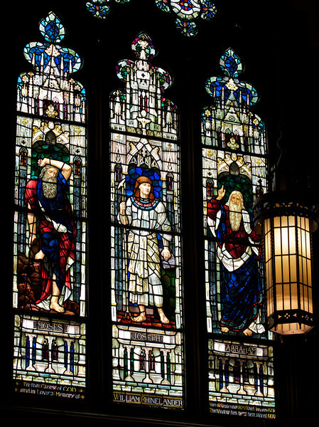 """Holy Trinity Episcopal Church Old Testament Stained Glass Windows by Henry Holiday <br><br><a href=""""http://www.holytrinity-nyc.org/stained-glass-windows/"""">From the Holy Trinity website on The Old Testament window:</a>  <br><br> """"Abraham, Joseph and Moses <br><br> South (right) Nave Clerestory Windows - Old Testament Windows <br><br> Abraham is shown holding a knife and the inscription in the small window reads """"By faith, when Abraham was tried, he offered up Isaac"""" (Hebrews 11:17).  <br><br> Genesis 22:1-2  After these things God Tested Abraham, and said to him, """"Abraham!"""" And he said, """"Here am I."""" He said, """"Take your son, your only son Isaac, whom you love, and go to the land of Moriah, and offer him there as a burnt offering upon one of the mountains of which I shall tell you.""""     <br><br> Genesis 22:10-13  Then Abraham put forth his hand, and took the knife to slay his son.  But the angel of the Lord called to him from heaven, and said, ëAbraham, Abraham!í And he said, """"Here as I"""".  He said, """"Do not lay your hand on the lad or do anything to him; for now I know that you fear God, seeing you have not withheld your son, your only son, from me."""" And Abraham lifted up his eyes and looked, and behold, behind him was a ram, caught in a thicket by his horns; and Abraham went and took the ram, and offered it up as a burnt offering instead of his son. <br><br> The center panel shows Joseph, Abraham's great grandson, who was sold into slavery by his brothers.  He was taken to Egypt where because he was able to interpret Pharaohís dreams, he was appointed ruler of Egypt.  The window shows Joseph wearing the robes of an Egyptian ruler and the inscription over him says """"Pharaoh said to Joseph, I have set thee over all Egypt."""" Genesis 41:41. <br><br> Joseph saved Egypt from a famine and Egypt became a haven for people escaping famine.  At Josephís request, his father Jacob and his family moved to Egypt to survive a drought.  They grew into the nation of Israel living in Egypt"""