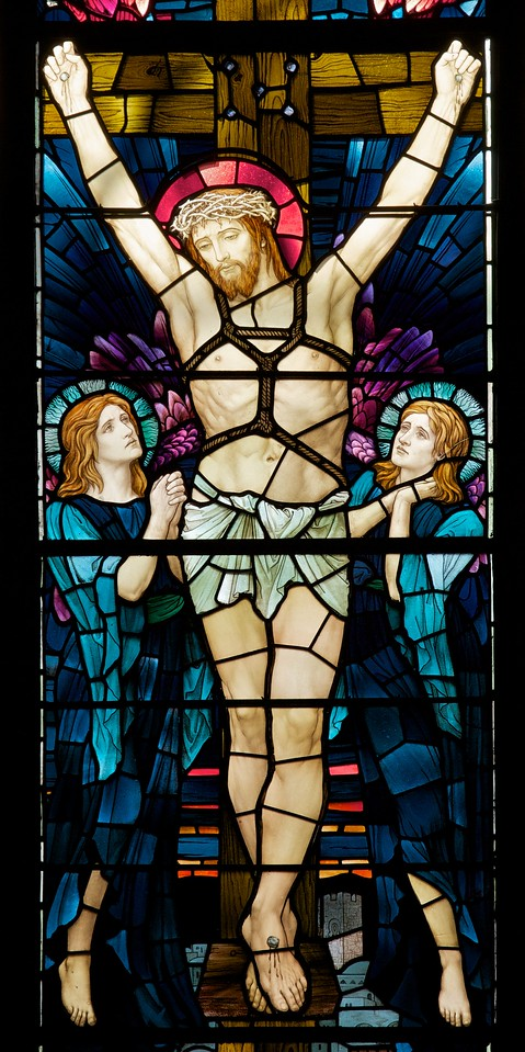 """Holy Trinity Episcopal Church Stained Glass Window by Henry Holiday <br><br><a href=""""http://www.holytrinity-nyc.org/stained-glass-windows/"""">From the Holy Trinity website on The Crucifixion south transept window:</a>  <br><br> """"In the main panel Jesus is seen fixed to the cross with the two thieves who were crucified with him on either side.  On the left side Mary Magdalene, Mary, the mother of Jesus and Solome, the mother of James and John.""""  <br><br> There are 17 stained glass windows created by Henry Holiday of London, all memorials to various members of the Rhinelander family. Holiday made all 17 except for the west window, which was completed by his daughter after his death. The windows are the only complete cycle of windows remaining by Holiday, and the church is one of a few churches in the world in which all windows are designed by one artist, according to church website. <br><br> Henry Holiday (1839-1927) was an English historical genre and landscape painter, stained glass designer, illustrator, and sculptor. He is considered to be a member of the Pre-Raphaelite school of art, according to <a href=""""http://en.wikipedia.org/wiki/Henry_Holiday"""">Wikipedia.</a> <br><br> Holiday was born in London and at age 15 was admitted to the Royal Academy. Through his friendship with several artists there, he was introduced to artists of the """"Pre-Raphaelite Brotherhood"""". This movement was to be pivotal in his future artistic and political life. From Wikipedia: """"The group's intention was to reform art by rejecting what it considered the mechanistic approach first adopted by Mannerist artists who succeeded Raphael and Michelangelo. Its members believed the Classical poses and elegant compositions of Raphael in particular had been a corrupting influence on the academic teaching of art, hence the name """"Pre-Raphaelite""""."""" <br><br> In 1861, Holiday accepted the job of stained glass window designer for Powell's Glass Works. During his time there he fulfilled over 300 commissions, mo"""