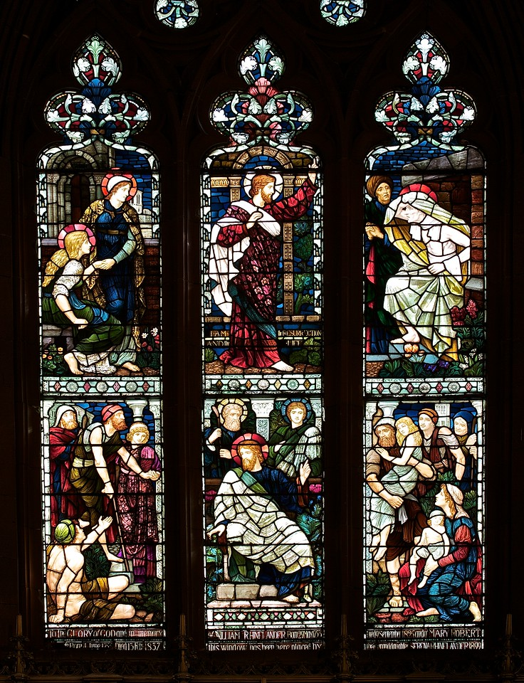 "Holy Trinity Episcopal Church Central Cancel Stained Glass Windows ""Healing of Bartimaeus and Raising of Lazarus from the Dead"" by Henry Holiday <br><br><a href=""http://www.holytrinity-nyc.org/stained-glass-windows/"">From the Holy Trinity website on The Central Chancel Window:</a>  <br><br> ""Central Chancel Window - Events in the Life of Jesus <br><br> The Lower Panel shows The Healing of Bartimaeus  - Jesus is shown in a crowd of sick people gathering around him and in the lower left corner is the blind beggar Bartimaeus.  <br><br> Luke 18:36-43  and hearing a multitude going by, he inquired what this meant.  They told him, ""Jesus of Nazareth is passing by.""  And he cried, ""Jesus, Son of David, have mercy on me!"" Those who were in front rebuked him to be silent; but he cried out all the more, ""Son of David, have mercy on me!""  And Jesus stopped, and commanded him to be brought to him; and when he came near, he asked him, ""What do you want me to do for you?""  He said, ""Lord, let me receive my sight.""  And Jesus said to him, ""Receive your sight; your faith has made you well.""  And immediately he received his sight and followed him, glorifying God; and all the people, when they saw it, gave praise to God. <br><br> The Upper Panel is the Raising of Lazarus from the Dead <br><br> The upper panel tells the story of the raising of Lazarus who had been dead for 4 days before Jesus arrived.  The body of Lazarus is seen coming out of the grave at the request of Jesus, while Mary and Martha, the sisters of Lazarus, look on in amazement. <br><br> John 11:40  Jesus said to her, ""Did I not tell you that if you would believe you would see the glory of God?""  So they took away the stone.  And Jesus lifted up his eyes and said, ""Father, I thank thee that thou hast heard me.  I knew that thou hearest me always, but I have said this on account of the people standing by, that they may believe that thou didst send me.""  When he had said this, he cried with a loud voice, ""Lazarus come out.""  The dead man came out, his hands and feet bound with bandages, and his face wrapped with a cloth.  Jesus said to them, ""Unbind him, and let him go""."" <br><br> There are 17 stained glass windows created by Henry Holiday of London, all memorials to various members of the Rhinelander family. Holiday made all 17 except for the west window, which was completed by his daughter after his death. The windows are the only complete cycle of windows remaining by Holiday, and the church is one of a few churches in the world in which all windows are designed by one artist, according to church website. <br><br> Henry Holiday (1839-1927) was an English historical genre and landscape painter, stained glass designer, illustrator, and sculptor. He is considered to be a member of the Pre-Raphaelite school of art, according to <a href=""http://en.wikipedia.org/wiki/Henry_Holiday"">Wikipedia.</a> <br><br> Holiday was born in London and at age 15 was admitted to the Royal Academy. Through his friendship with several artists there, he was introduced to artists of the ""Pre-Raphaelite Brotherhood"". This movement was to be pivotal in his future artistic and political life. From Wikipedia: ""The group's intention was to reform art by rejecting what it considered the mechanistic approach first adopted by Mannerist artists who succeeded Raphael and Michelangelo. Its members believed the Classical poses and elegant compositions of Raphael in particular had been a corrupting influence on the academic teaching of art, hence the name ""Pre-Raphaelite""."" <br><br> In 1861, Holiday accepted the job of stained glass window designer for Powell's Glass Works. During his time there he fulfilled over 300 commissions, mostly for customers in the U.S. He left in 1891 to set up his own glass works in Hampstead, producing stained glass, mosaics, enamels and sacerdotal objects. <br><br> Holiday's stained glass work can be found all over Britain and some of his best is at Westminster Abbey according to Wikipedia. <br><br> In addition to his stained glass work, Holiday was a painter; his works include The Burgess of Calais, The Rhine Maiders, Dante and Beatrice. He was commissioned by Lewis Carroll to illustrate The Hunting of the Snark. He remained friends with the author throughout his life."