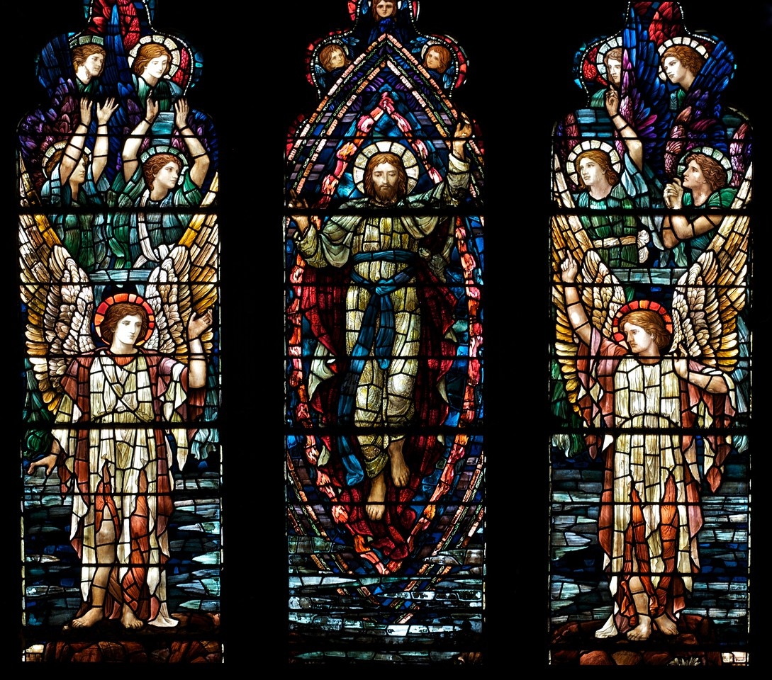 """Holy Trinity Episcopal Church Ascension Stained Glass Window by Henry Holiday <br><br><a href=""""http://www.holytrinity-nyc.org/stained-glass-windows/"""">From the Holy Trinity website on The Ascension nouth transept window:</a>  <br><br> """"In the main panels of the window, the figure of Christ is shown being received into Heaven by a host of angels."""" <br><br> There are 17 stained glass windows created by Henry Holiday of London, all memorials to various members of the Rhinelander family. Holiday made all 17 except for the west window, which was completed by his daughter after his death. The windows are the only complete cycle of windows remaining by Holiday, and the church is one of a few churches in the world in which all windows are designed by one artist, according to church website. <br><br> Henry Holiday (1839-1927) was an English historical genre and landscape painter, stained glass designer, illustrator, and sculptor. He is considered to be a member of the Pre-Raphaelite school of art, according to <a href=""""http://en.wikipedia.org/wiki/Henry_Holiday"""">Wikipedia.</a> <br><br> Holiday was born in London and at age 15 was admitted to the Royal Academy. Through his friendship with several artists there, he was introduced to artists of the """"Pre-Raphaelite Brotherhood"""". This movement was to be pivotal in his future artistic and political life. From Wikipedia: """"The group's intention was to reform art by rejecting what it considered the mechanistic approach first adopted by Mannerist artists who succeeded Raphael and Michelangelo. Its members believed the Classical poses and elegant compositions of Raphael in particular had been a corrupting influence on the academic teaching of art, hence the name """"Pre-Raphaelite""""."""" <br><br> In 1861, Holiday accepted the job of stained glass window designer for Powell's Glass Works. During his time there he fulfilled over 300 commissions, mostly for customers in the U.S. He left in 1891 to set up his own glass works in Hampstead, producin"""