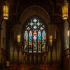 "Holy Trinity Episcopal Church Organ by Rieger-Orgelblau and Stained Glass Windows by Henry Holiday <br><br> The pipe organ in the south transept was designed and constructed by Rieger-Orgelblau of Austria and installed in 1987. The company started in 1845 <a href=""http://www.rieger-orgelbau.com/en/"">According to the company website.</a>  <br><br><a href=""http://en.wikipedia.org/wiki/Rieger_Orgelbau"">Wikipedia</a> has a list of notable Rieger organs.  <br><br><a href=""http://www.holytrinity-nyc.org/stained-glass-windows/"">From the Holy Trinity website on The Crucifixion south transept window:</a>  <br><br> ""In the main panel Jesus is seen fixed to the cross with the two thieves who were crucified with him on either side.  On the left side Mary Magdalene, Mary, the mother of Jesus and Solome, the mother of James and John.  In the lower right hand of the picture a group of Roman soldiers are shown casting lots for the garments of Christ.  <br><br> John 19:23  When the soldiers had crucified Jesus they took his garments and made four parts, one for each soldier; also his tunic.  But the tunic was without seam, woven from top to Bottom; so they said to one another, ""Let us not tear it, but cast lots for it to see whose it shall be.""  This was to fulfill the scripture, ""They parted my garments among them, and for my clothing they cast lots."" <br><br> The whole scene is surmounted by a host of angels praying and waiting to receive the soul of the crucified Christ. <br><br> In the tracery above the main portion of the window, there is a small window containing the symbol ìXPî, the abbreviation of Christís name in Greek.  There are also four small cloverleaf windows which continue the story after the crucifixion.  From the left to the right they portray Christ being taken down from the cross; Christ being placed in the he tomb; a soldier standing guard; and finally, Martha and Mary bringing spices for Christís body. <br><br> Matthew 27:57  When it was evening, there came a rich man from Arimathea, named Joseph, who was also a disciple of Jesus.  He went to Pilate and asked for the body of Jesus; then Pilate ordered it to be given to him.  So Joseph took the body and wrapped it in a lean linen cloth and laid it in his own new tomb, which he had hewn in the rock.  <br><br> Matthew 27:65  Pilate said to them, You have a guard of soldiers; go, make it as secure as you can.î So they went with the guard and made the tomb secure by sealing the stone. <br><br> Mark 16:1  When the Sabbath was over, Mary Magdalene and Mary the mother of James, and Salome bought spices, so they might go and anoint him.  And very early on the first day of the week, when the sun had risen, they went to the tomb."" <br><br> There are 17 stained glass windows created by Henry Holiday of London, all memorials to various members of the Rhinelander family. Holiday made all 17 except for the west window, which was completed by his daughter after his death. The windows are the only complete cycle of windows remaining by Holiday, and the church is one of a few churches in the world in which all windows are designed by one artist, according to church website. <br><br> Henry Holiday (1839-1927) was an English historical genre and landscape painter, stained glass designer, illustrator, and sculptor. He is considered to be a member of the Pre-Raphaelite school of art, according to <a href=""http://en.wikipedia.org/wiki/Henry_Holiday"">Wikipedia.</a> <br><br> Holiday was born in London and at age 15 was admitted to the Royal Academy. Through his friendship with several artists there, he was introduced to artists of the ""Pre-Raphaelite Brotherhood"". This movement was to be pivotal in his future artistic and political life. From Wikipedia: ""The group's intention was to reform art by rejecting what it considered the mechanistic approach first adopted by Mannerist artists who succeeded Raphael and Michelangelo. Its members believed the Classical poses and elegant compositions of Raphael in particular had been a corrupting influence on the academic teaching of art, hence the name ""Pre-Raphaelite""."" <br><br> In 1861, Holiday accepted the job of stained glass window designer for Powell's Glass Works. During his time there he fulfilled over 300 commissions, mostly for customers in the U.S. He left in 1891 to set up his own glass works in Hampstead, producing stained glass, mosaics, enamels and sacerdotal objects. <br><br> Holiday's stained glass work can be found all over Britain and some of his best is at Westminster Abbey according to Wikipedia. <br><br> In addition to his stained glass work, Holiday was a painter; his works include The Burgess of Calais, The Rhine Maiders, Dante and Beatrice. He was commissioned by Lewis Carroll to illustrate The Hunting of the Snark. He remained friends with the author throughout his life."