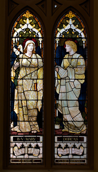 "Faith and Charity by Henry Holiday <br><br> From the <a href=""http://www.churchoftheincarnation.org/about-incarnation/landmark-building/the-window-tour/faith-charity-10/"">Incarnation website:</a>  <br><br> ""In the nave is a window designed to show to sides of the Christian character, Faith and Charity, as suggested by the figures of the Virgin Mary and Dorcas (an early pious Christian woman who was raised from the dead by Saint Peter and noted for her good works; she is sometimes called Tabitha). The upper portion displays Christ and again the Virgin Mary with the infant Jesus. The inscription reads: In as much as you have done it with one of the least of these my brethren, you have done it with me. The window was designed by Henry Holiday of London, after a design by Edward Burne-Jones, a Pre-Raphaelite painter and close associate of William Morris."""