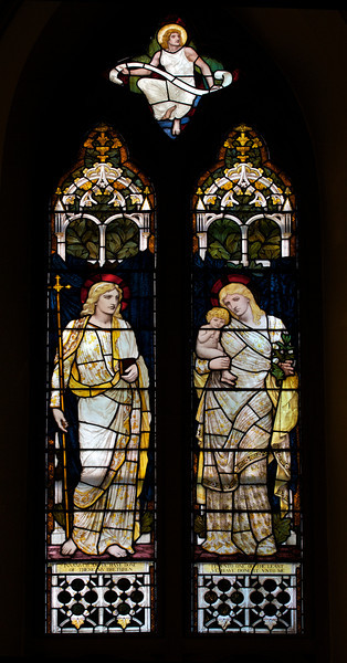 """Faith and Charity by Henry Holiday <br><br> From the <a href=""""http://www.churchoftheincarnation.org/about-incarnation/landmark-building/the-window-tour/faith-charity-10/"""">Incarnation website:</a>  <br><br> In the nave is a window designed to show to sides of the Christian character, Faith and Charity, as suggested by the figures of the Virgin Mary and Dorcas (an early pious Christian woman who was raised from the dead by Saint Peter and noted for her good works; she is sometimes called Tabitha). The upper portion displays Christ and again the Virgin Mary with the infant Jesus. The inscription reads: In as much as you have done it with one of the least of these my brethren, you have done it with me. The window was designed by Henry Holiday of London, after a design by Edward Burne-Jones, a Pre-Raphaelite painter and close associate of William Morris."""